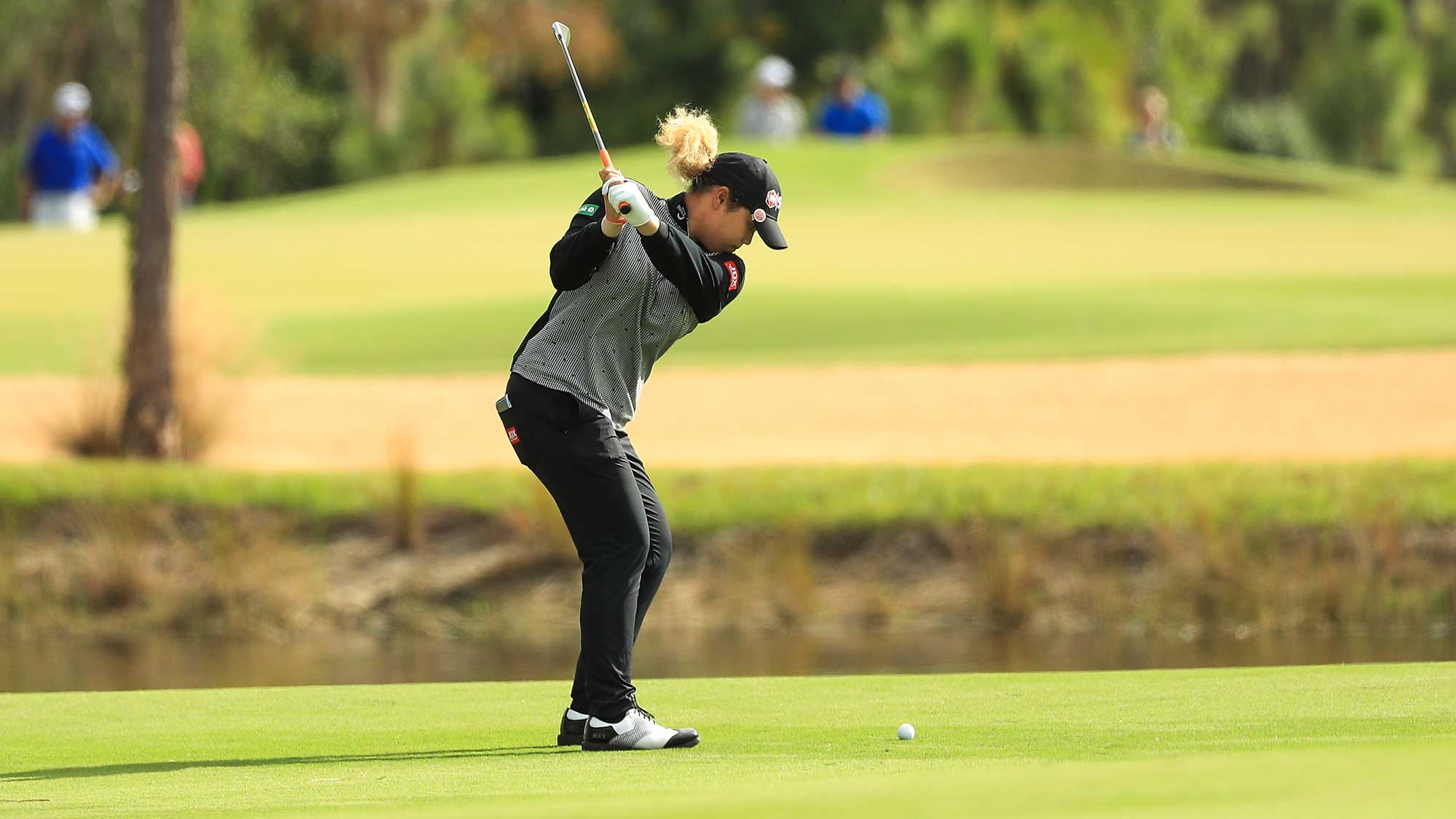 Ariya Jutanugarn of Thailand plays her third shot on the first hole during the final round of the LPGA CME Group Tour Championship