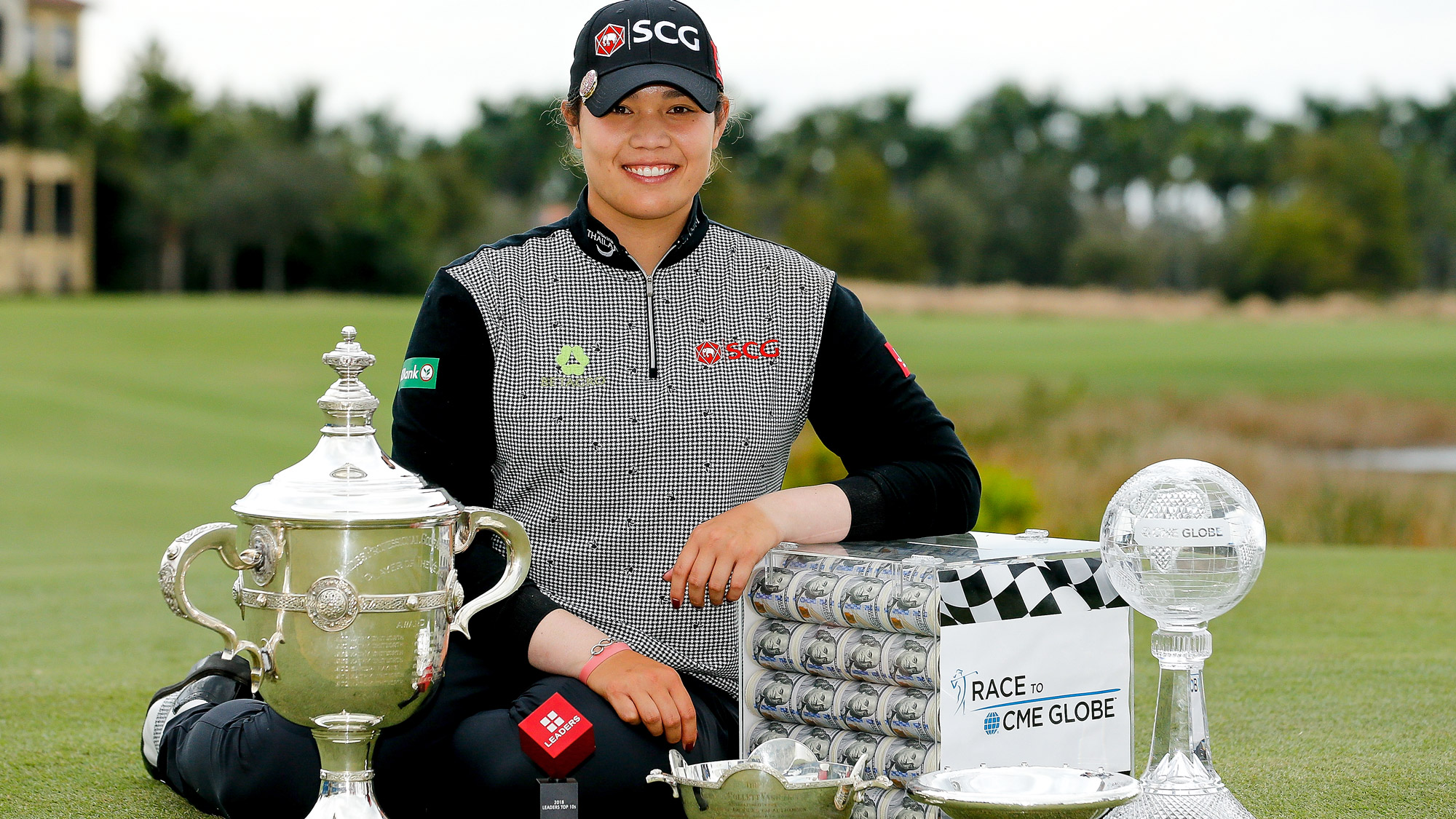 Ariya Jutanugarn of Thailand poses for a photo with (left to right) the Rolex Player of the Year trophy, Leaders Top 10 Competition Trophy, Vare trophy, Rolex Annika Major award and the Race to the CME Globe trophy after the final round of the LPGA CME Group Tour Championship