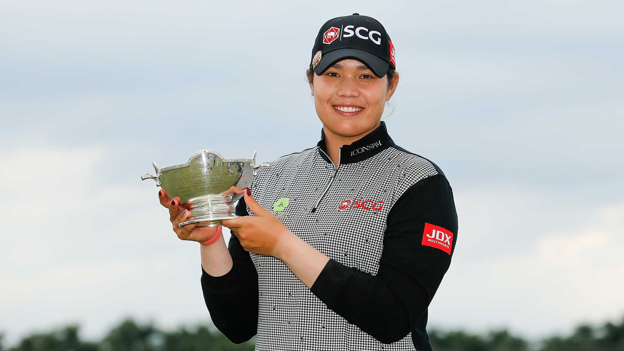 Ariya Jutanugarn of Thailand poses for a photo with the Vare Trophy after the final round of the LPGA CME Group Tour Championship