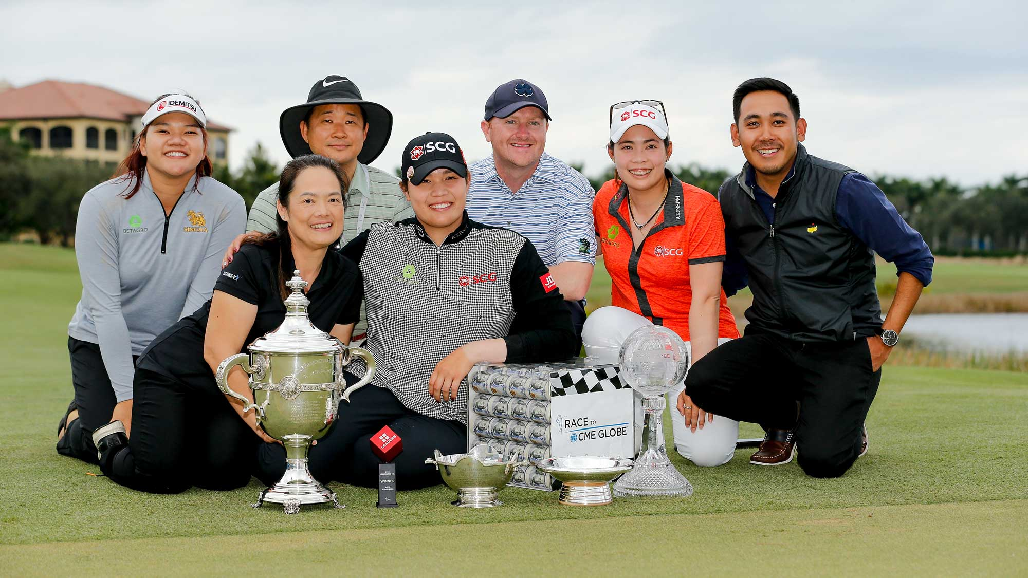 Ariya Jutanugarn of Thailand and her family pose for a photo with (left to right) the Rolex Player of the Year trophy, Leaders Top 10 Competition Trophy, Vare trophy, Rolex Annika Major award and the Race to the CME Globe trophy after the final round of the LPGA CME Group Tour Championship