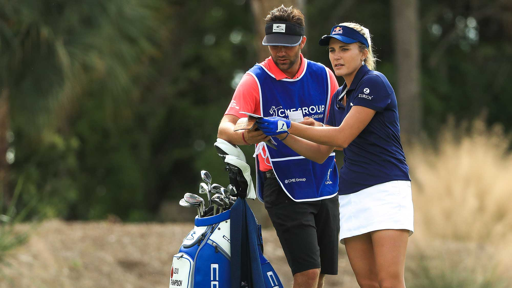 Lexi Thompson talks with her caddie on the second hole during the final round of the LPGA CME Group Tour Championship