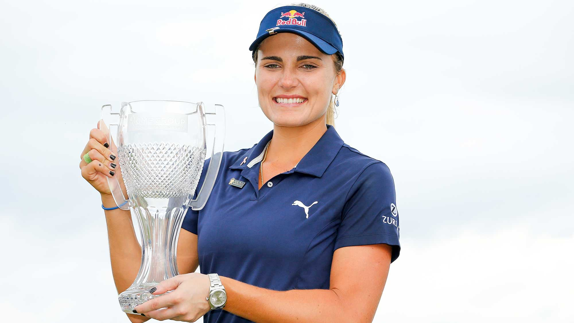 Lexi Thompson poses for a photo with the CME Group Tour Championship trophy
