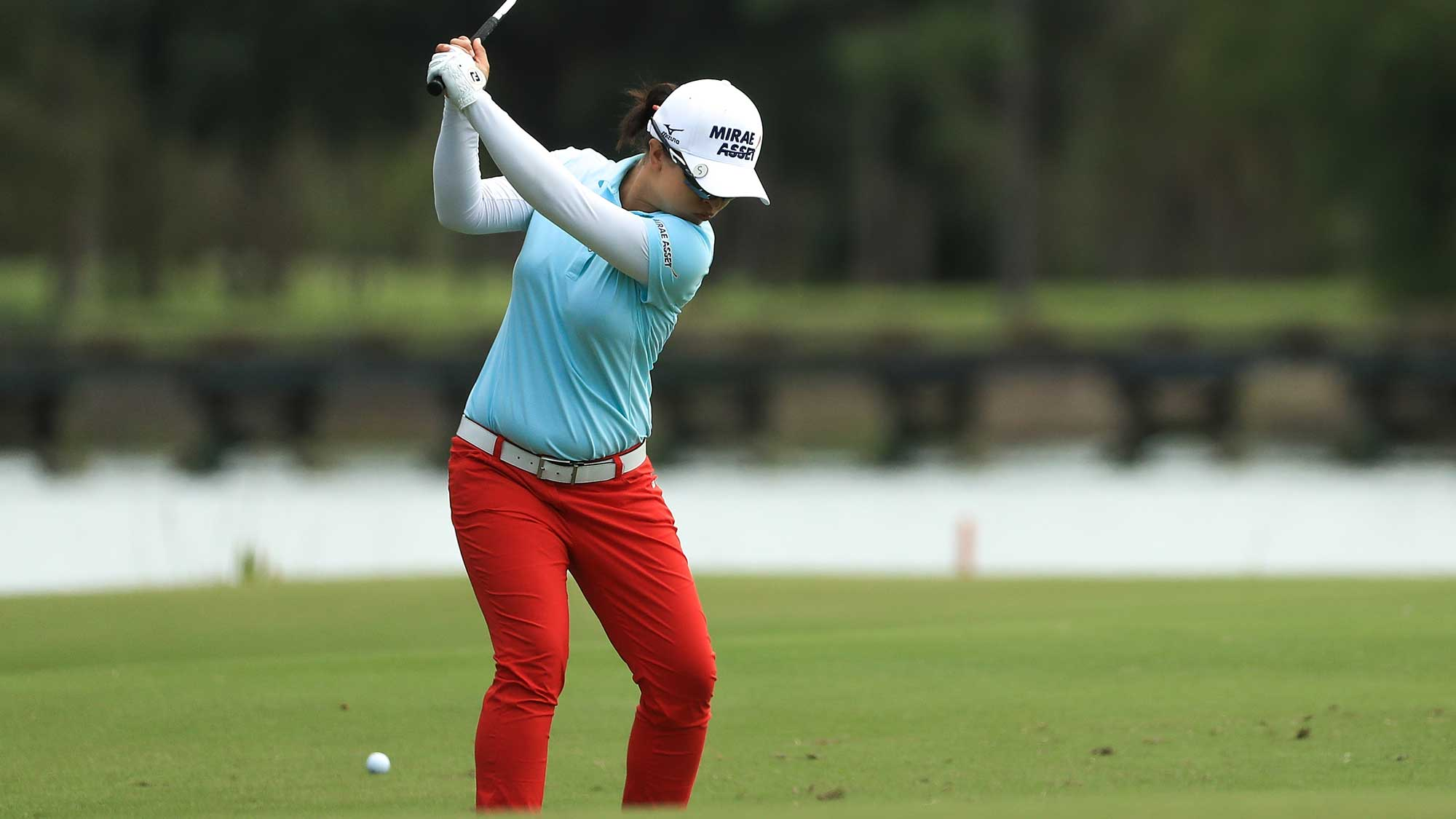 Sei Young Kim of Korea plays her second shot on the first hole during the final round of the LPGA CME Group Tour Championship