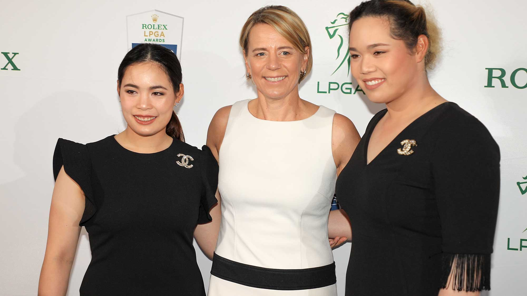 Moriya Jutanugarn (left) and Ariya Jutanugarn of Thailand pose for a photo with former LPGA golfer Annika Sorenstam on the green carpet during the LPGA Rolex Players Awards at the Ritz-Carlton Golf Resort