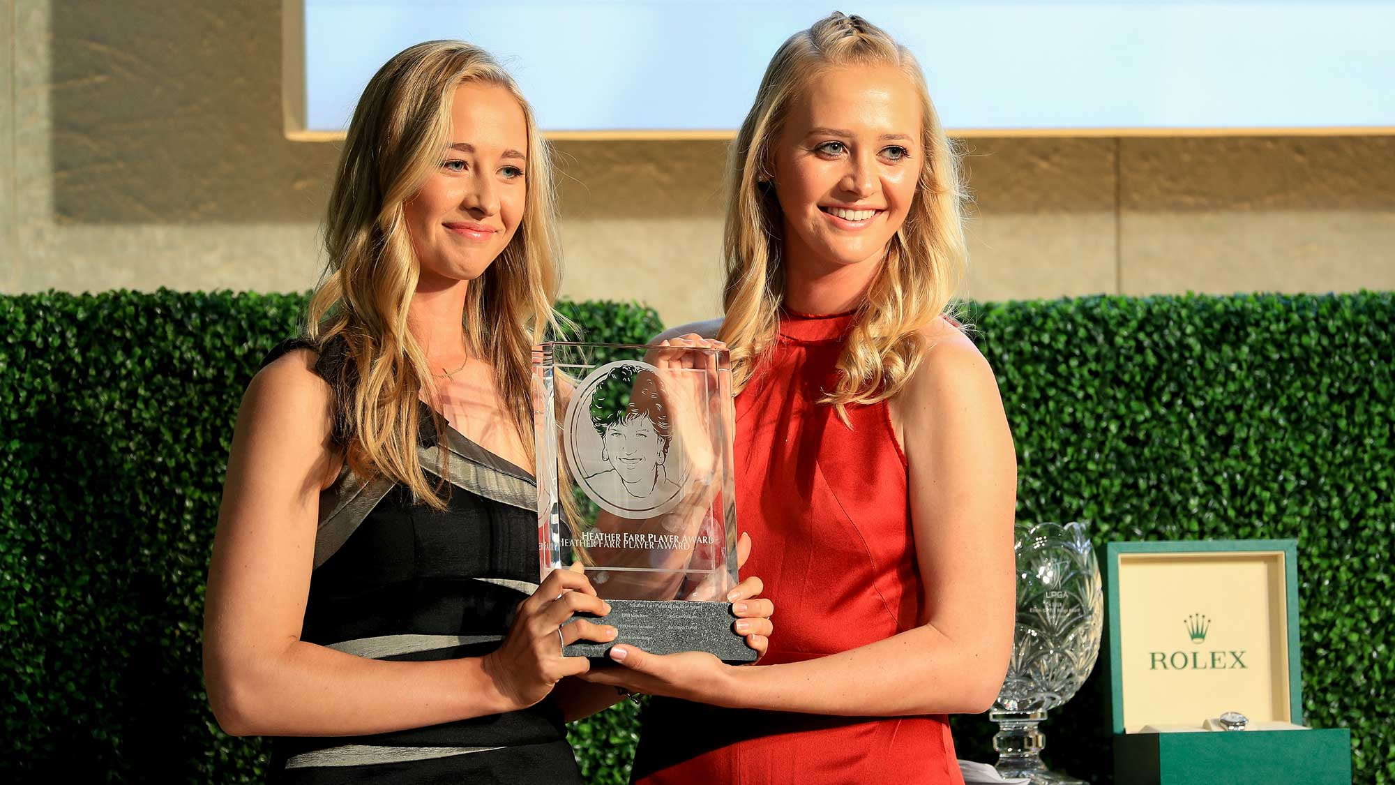 Nelly Korda presents Jessica Korda with the Heather Farr Pererverance Award during the LPGA Rolex Players Awards at the Ritz-Carlton Golf Resort