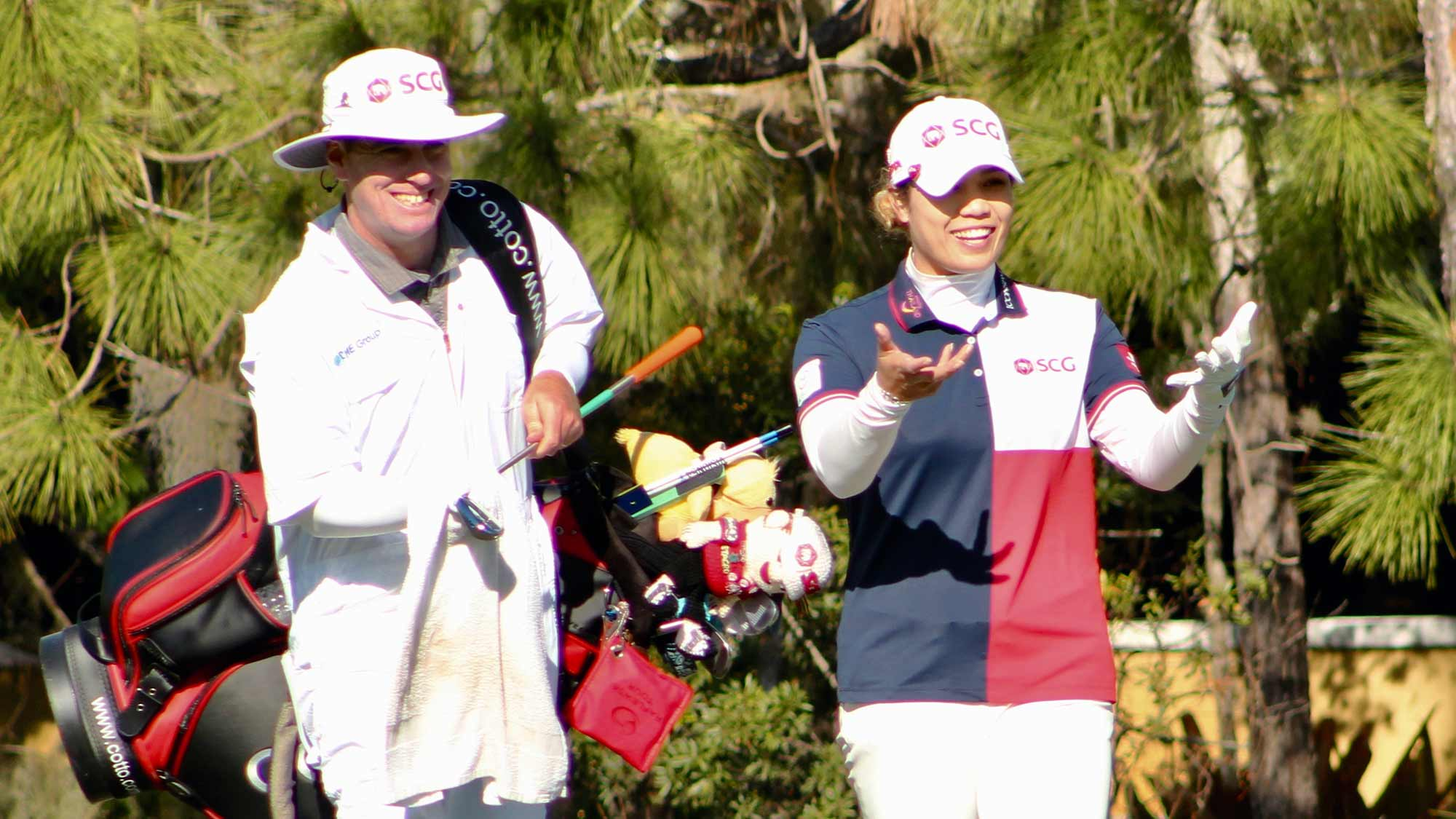 Ariya Jutanugarn and her caddie Peter Godfrey walk together during the third round of the 2019 CME Group Tour Championship