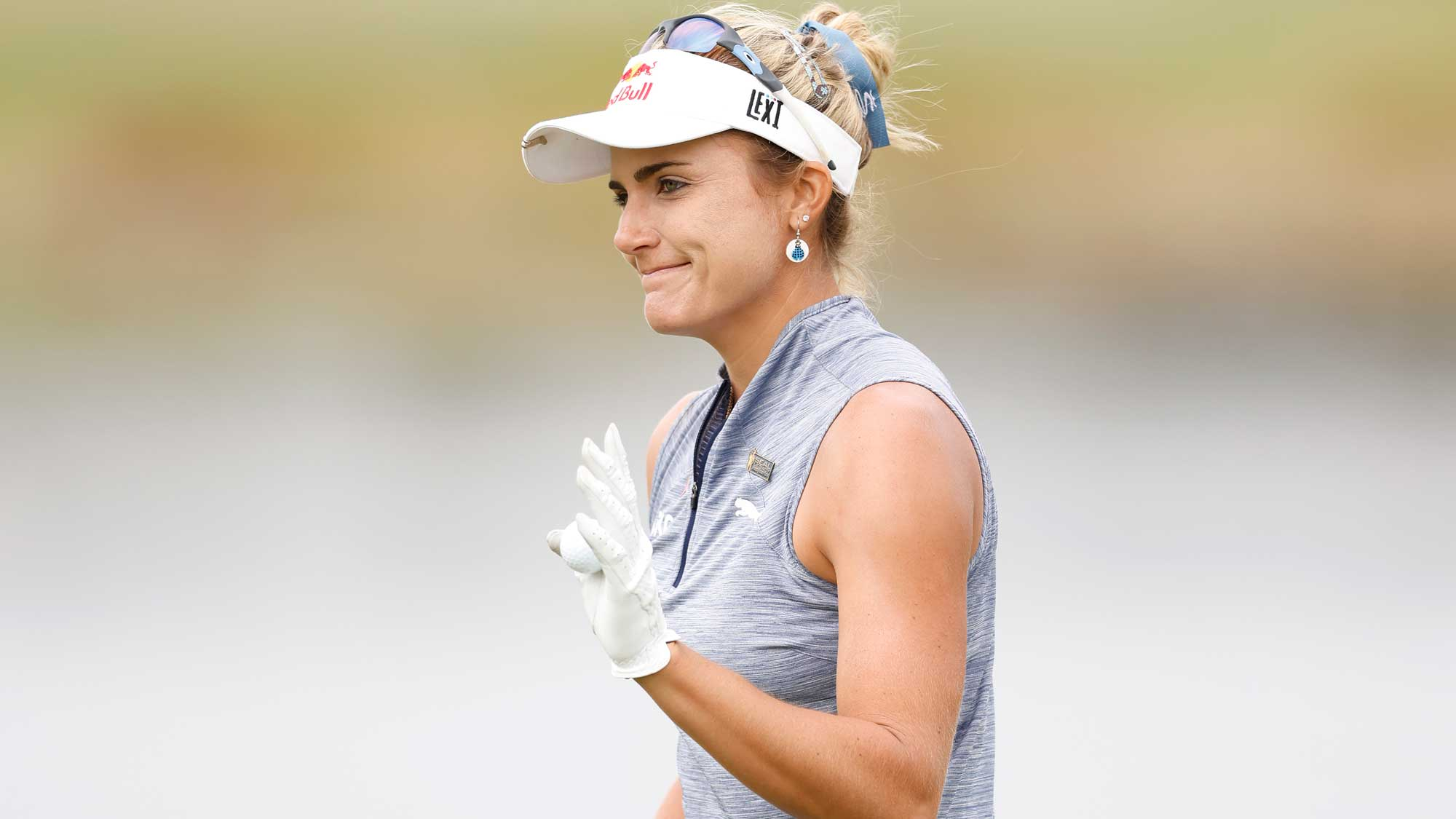 Lexi Thompson of the United States reacts after making a birdie putt on the 18th green during the first round of the CME Group Tour Championship
