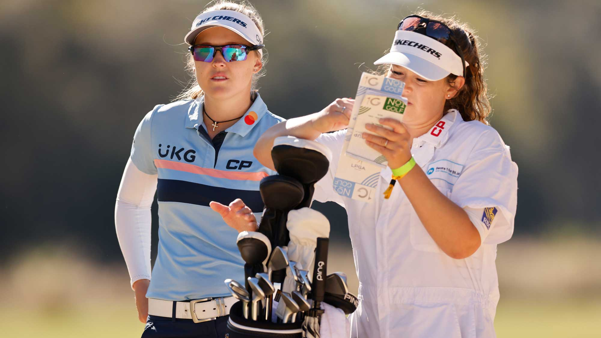 Brooke Henderson of Canada talks with her caddie, Brittany Henderson, on the third hole during the third round of the CME Group Tour Championship