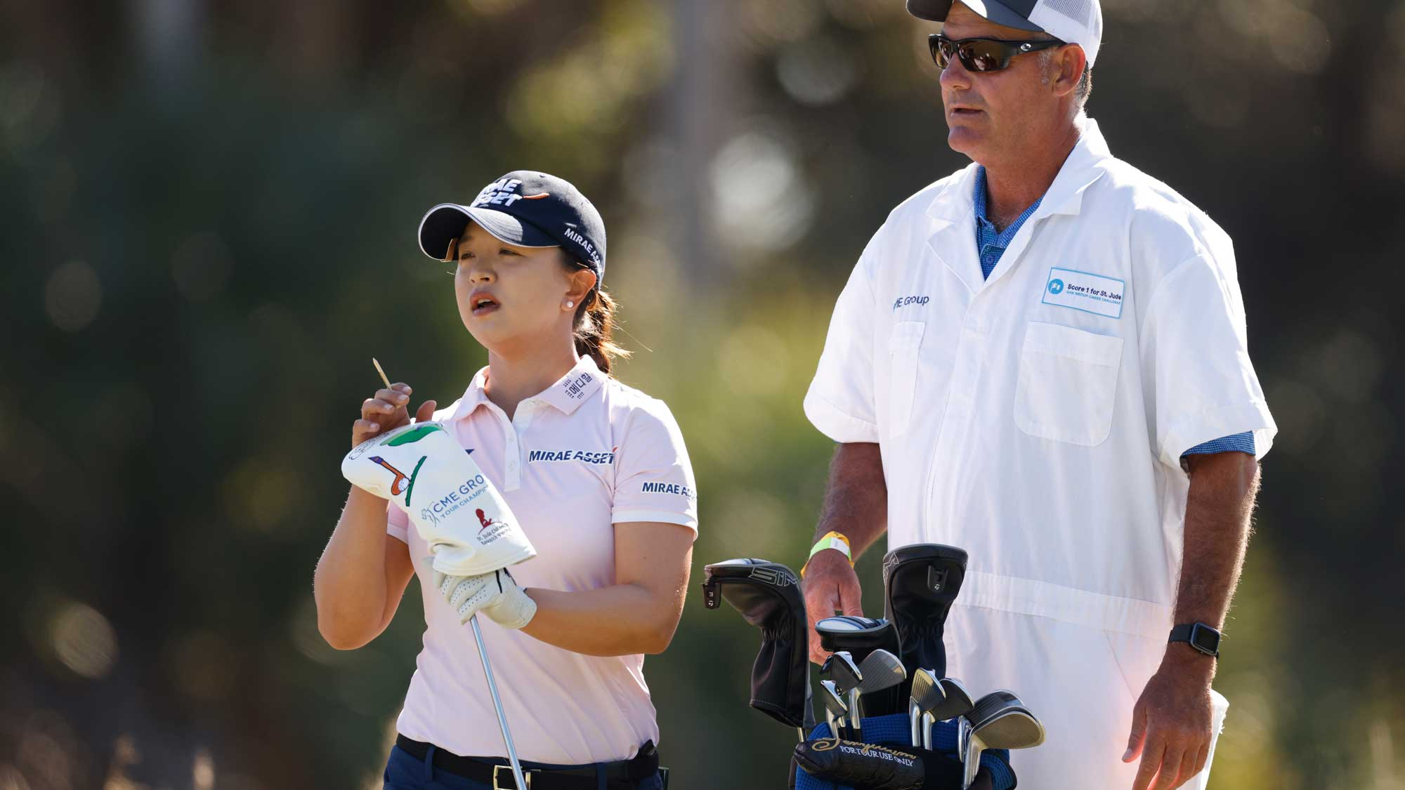 Sei-Young Kim of Korea talks with her caddie on the third hole during the third round of the CME Group Tour Championship
