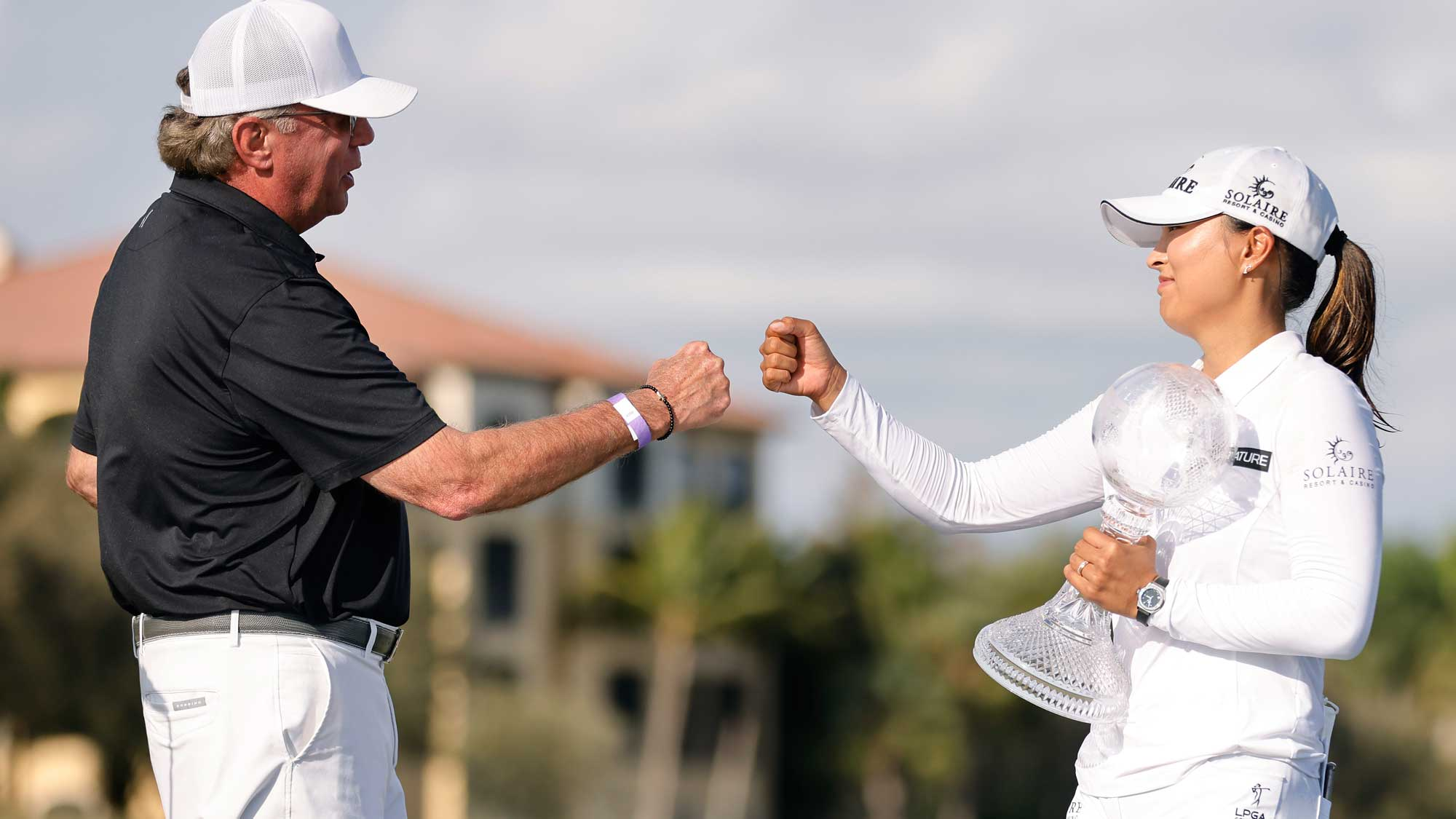 CME Group CEO Terry Duffy (L) fist bumps Jin Young Ko of Korea after she won the CME Group Tour Championship