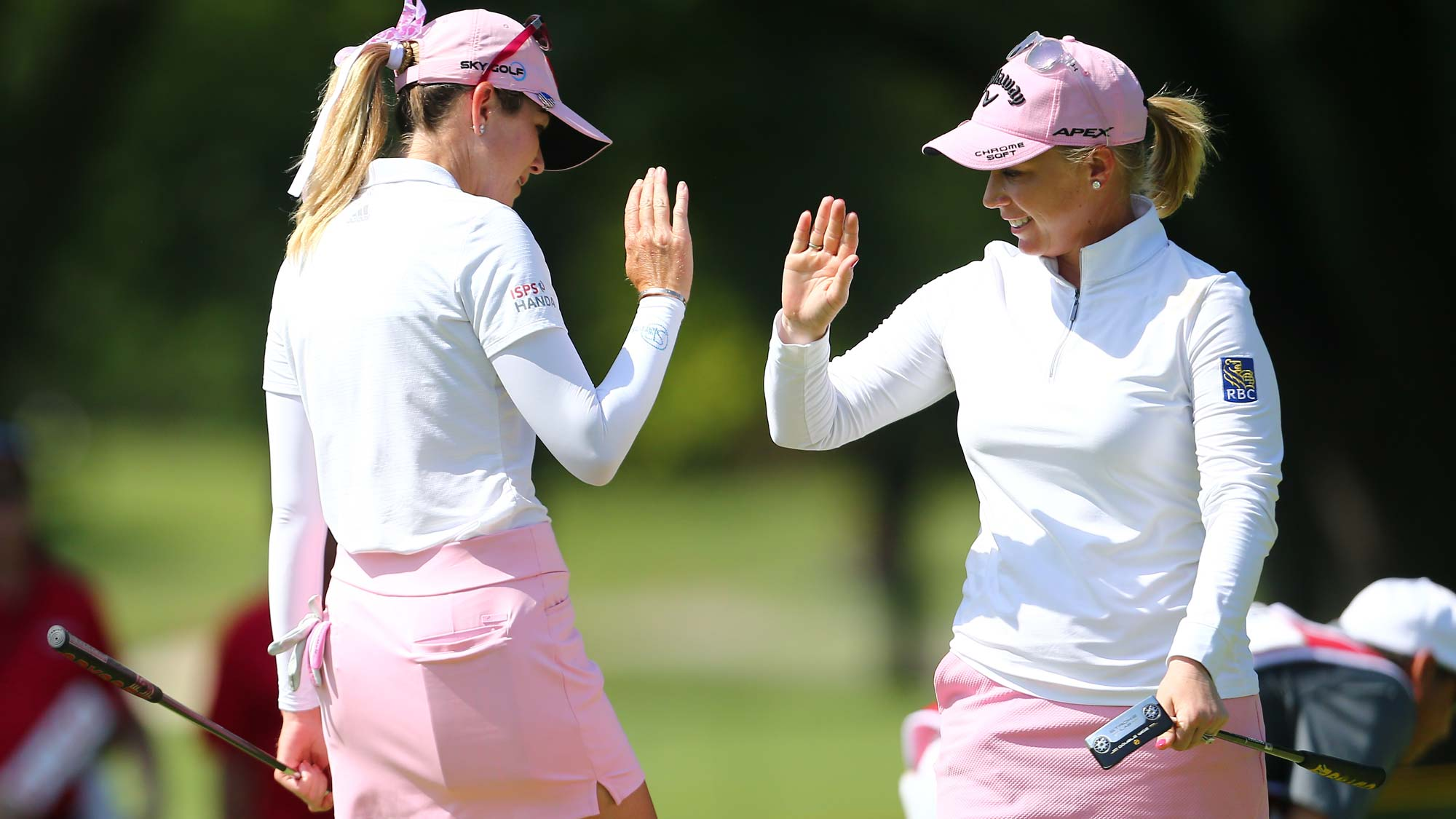 (R-L) Morgan Pressel celebrates her birdie putt with Paula Creamer on the 12th hole during the first round of the Dow Great Lakes Bay Invitational