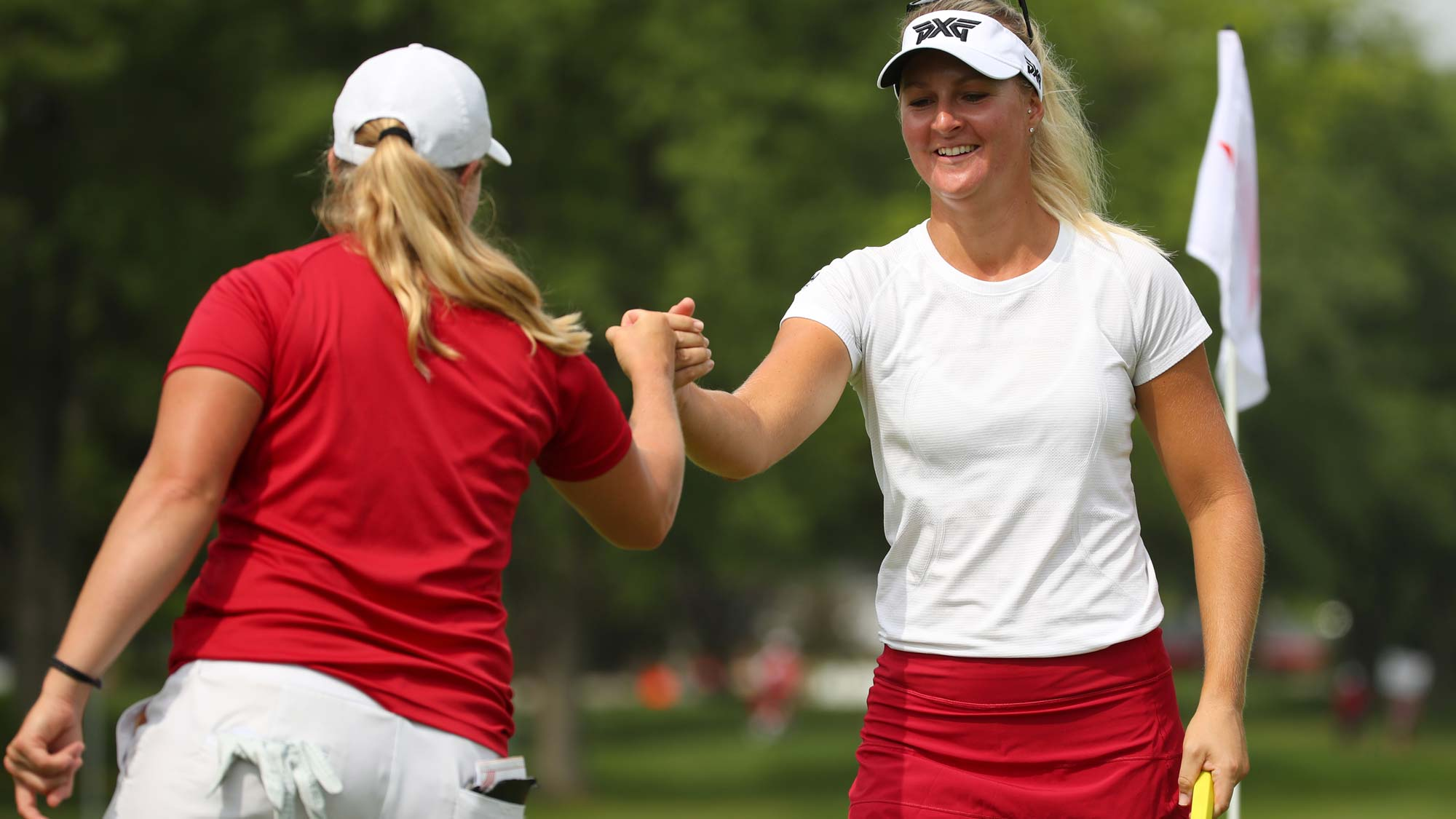 Teammates Anna Nordqvist (R) and Caroline Hedwall of Sweden celebrate Nordqvist's birdie on the first hole during round two of the Dow Great Lakes Bay Invitational