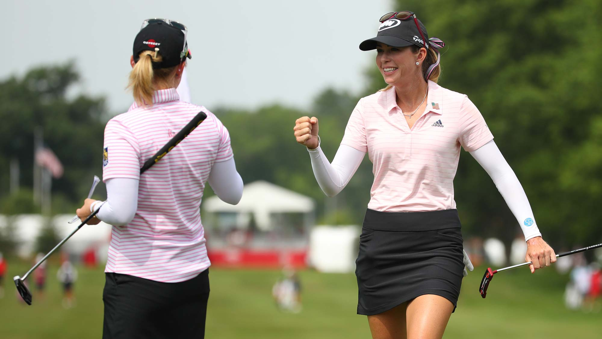 Teammates Paula Creamer (R) and Morgan Pressel celebrate on the first green during round two of the Dow Great Lakes Bay Invitational