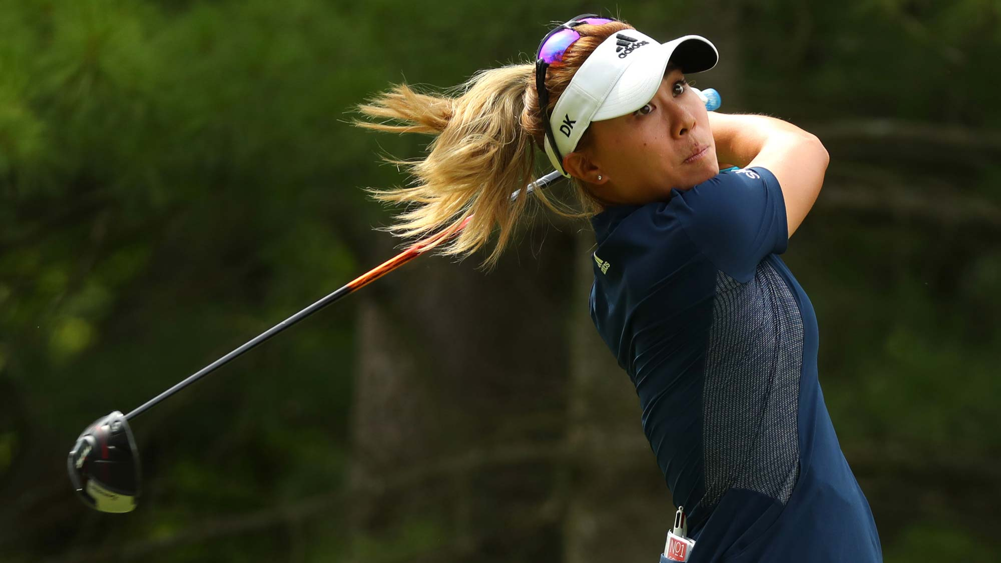 Danielle Kang watches her drive on the second hole during round two of the Dow Great Lakes Bay Invitational