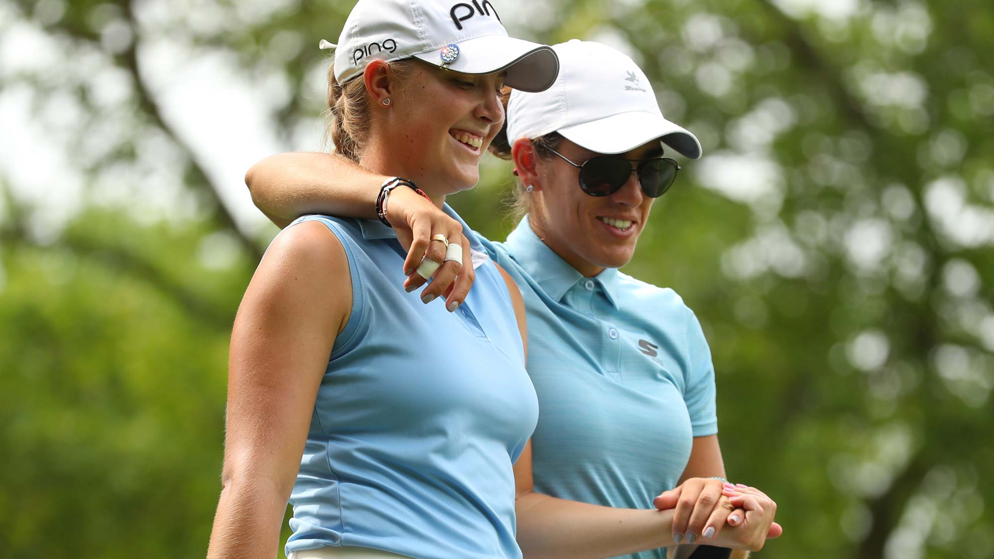 Jennifer Kupcho (L) and Maria Fassi of Mexico walk off the second tee during round two of the Dow Great Lakes Bay Invitational