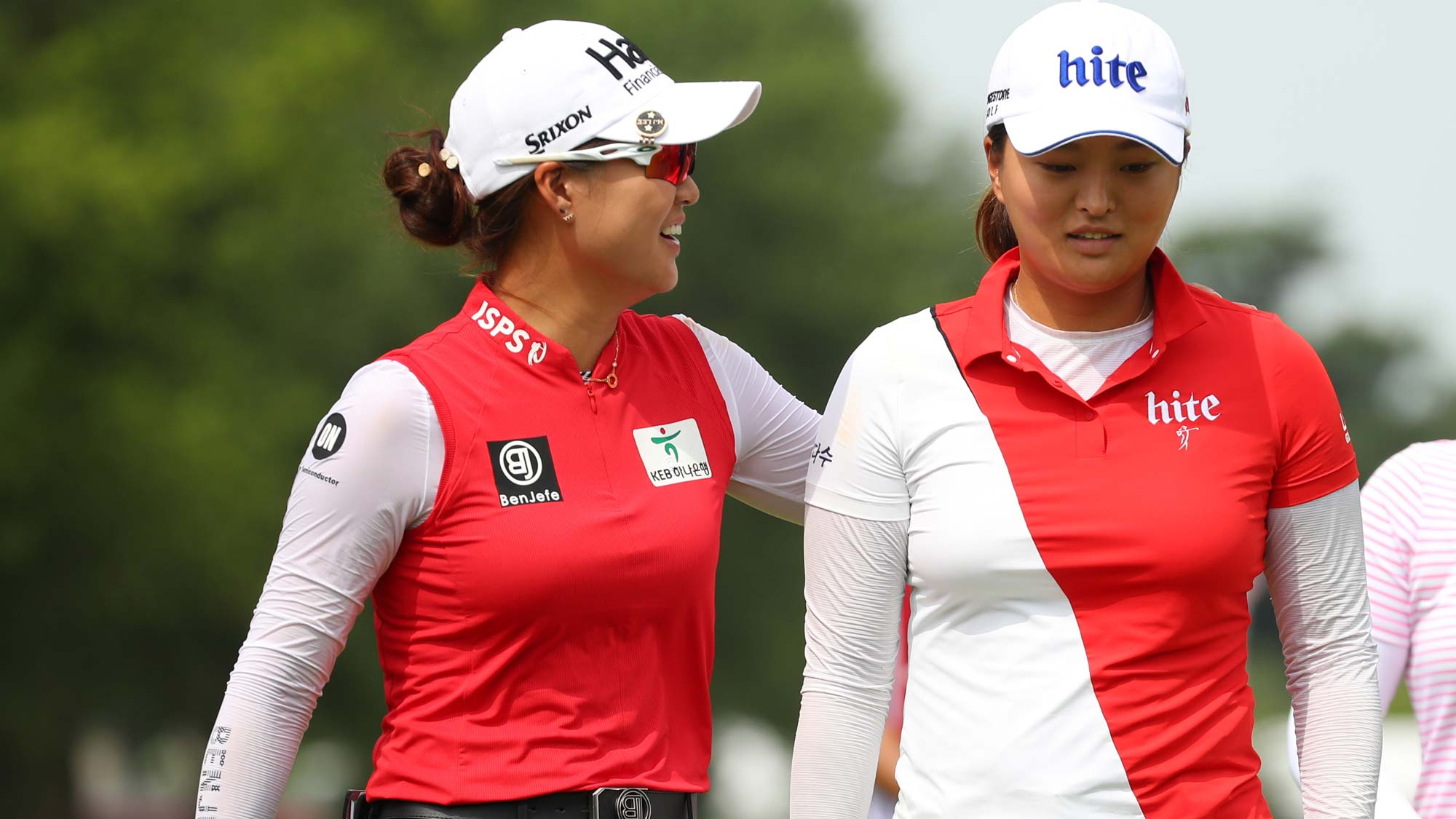 Teammates Minjee Lee of Australia (L) and Jin Young Ko of South Korea walk off the first green during round two of the Dow Great Lakes Bay Invitational