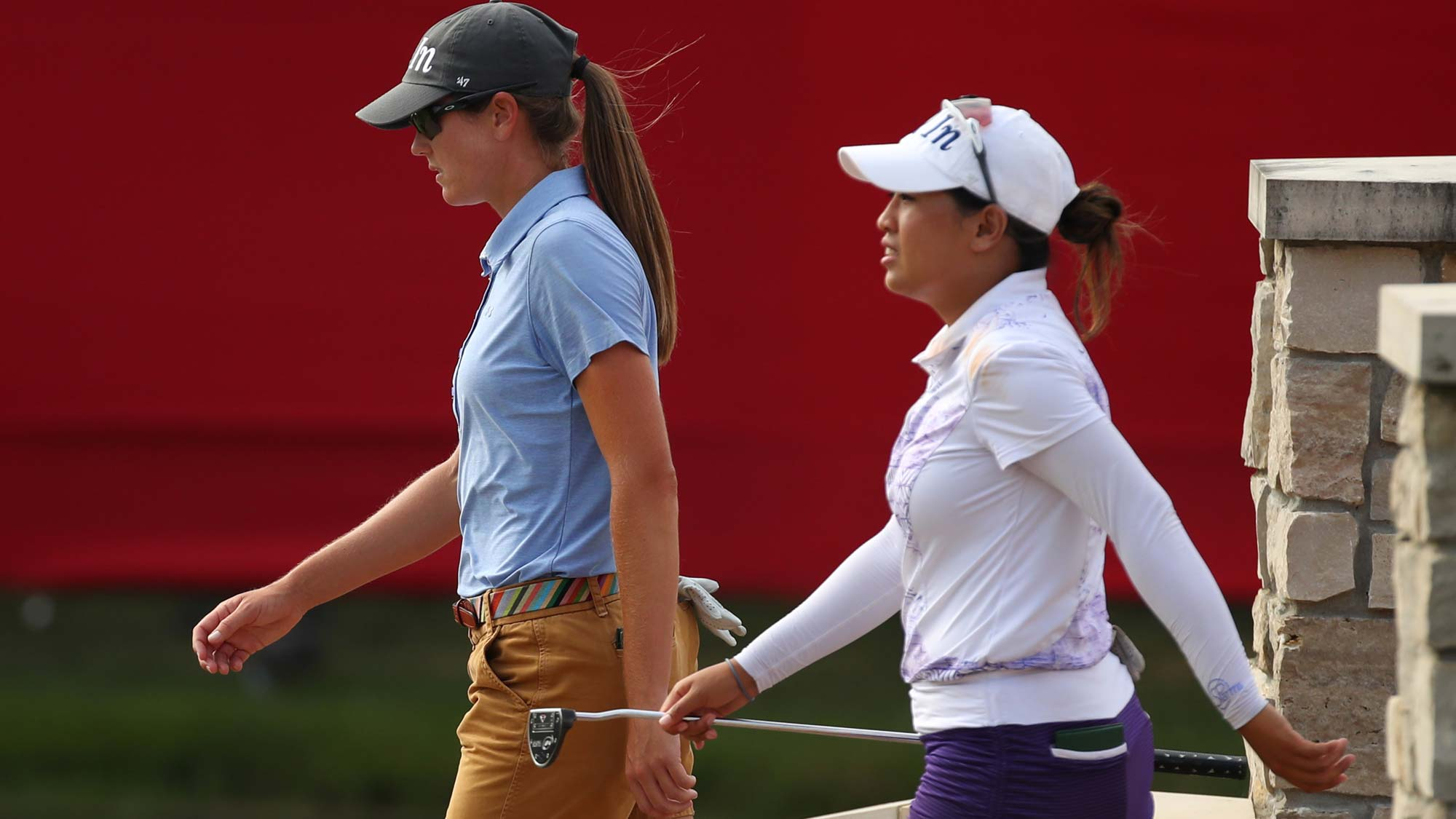 Teammates Jasmine Suwannapura of Thailand (R) and Cydney Clanton of the United States walk to the 18th green during round three of the Dow Great Lakes Bay Invitational