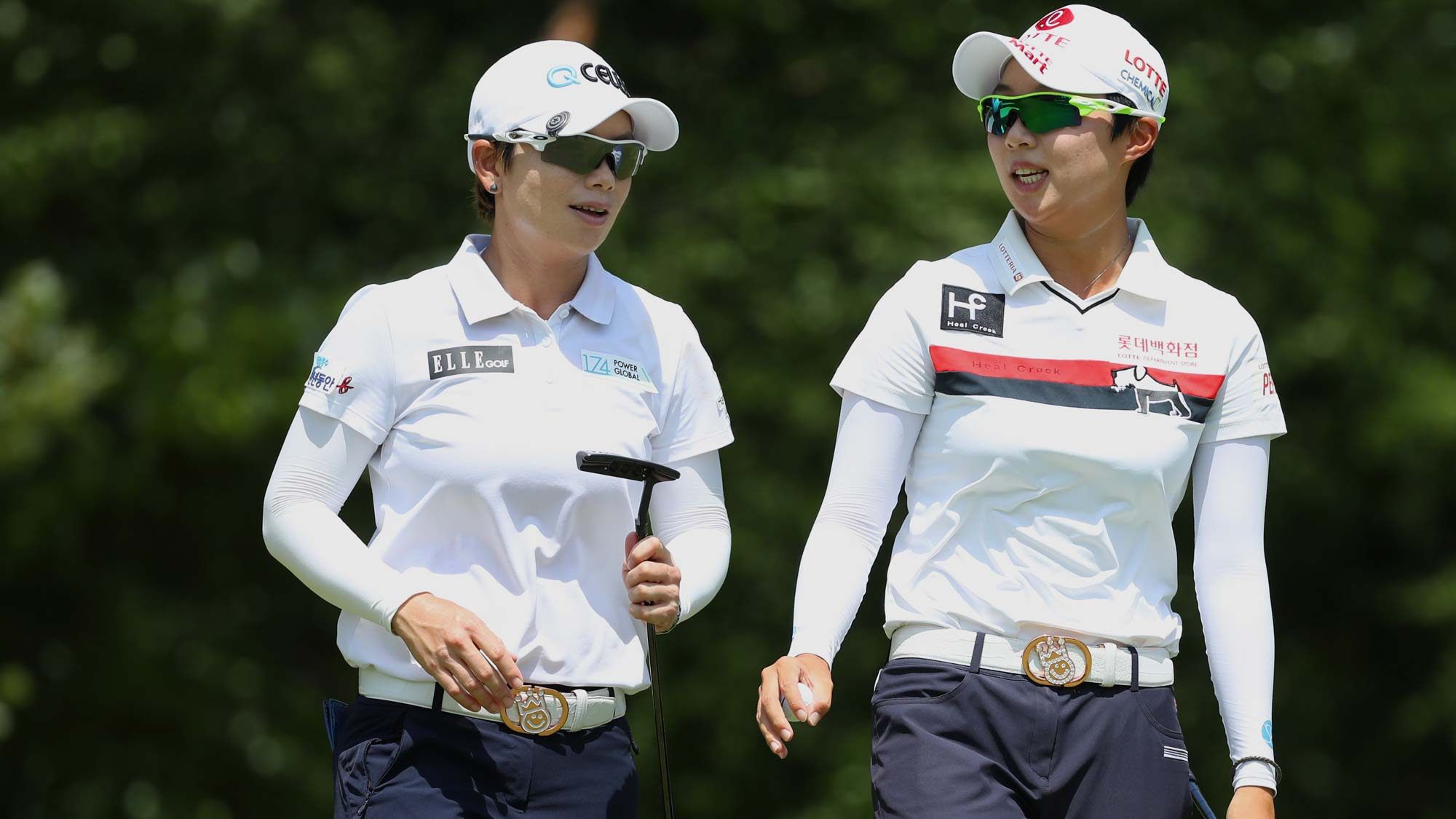 Teammates Hyo Joo Kim and Eun-Hee JI of South Korea walk off the sixth green during round three of the Dow Great Lakes Bay Invitational