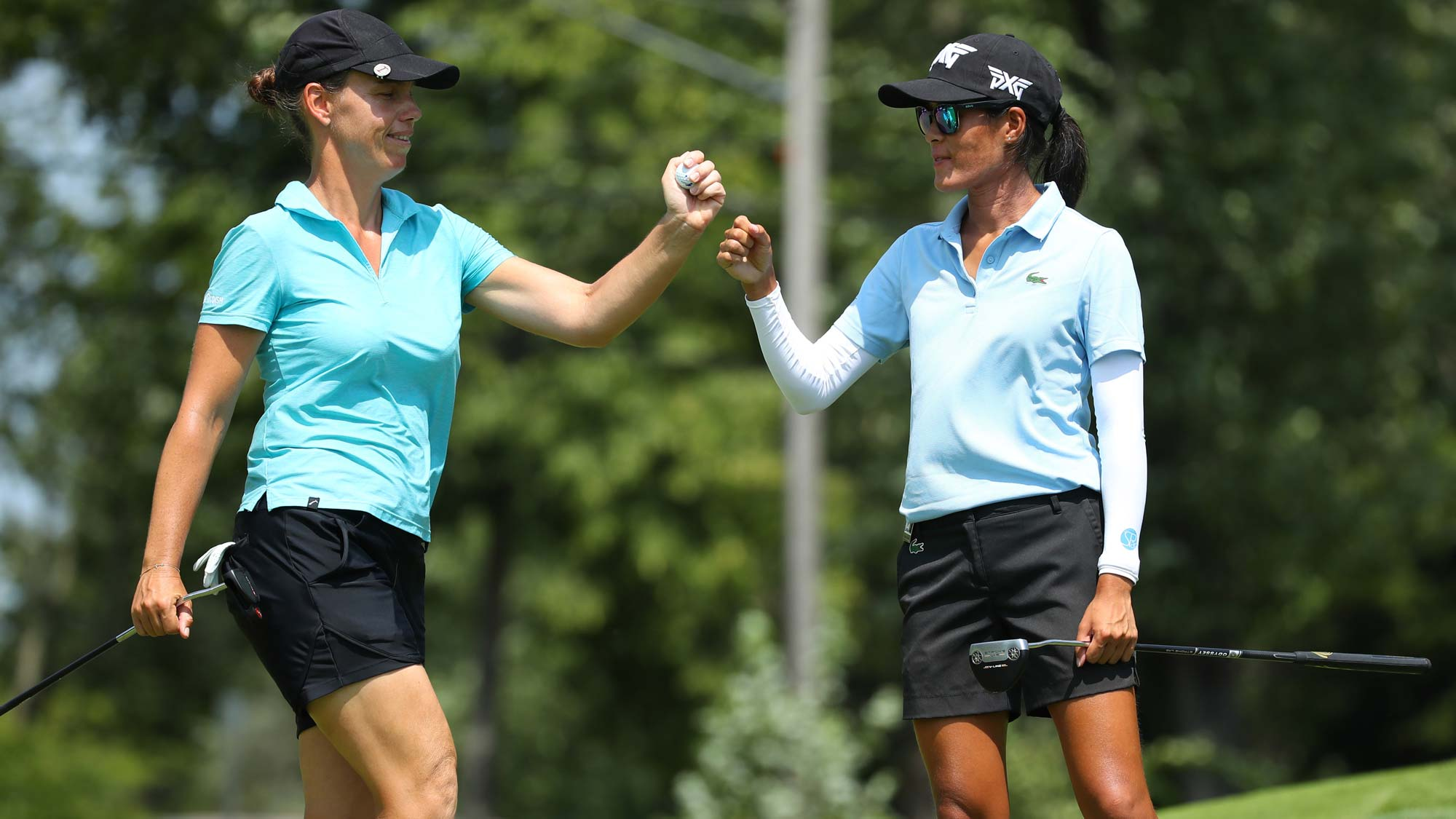 Teammates Celine Boutier (R) and Karine Icher of Italy celebrate a birdie on the sixth green during round three of the Dow Great Lakes Bay Invitational