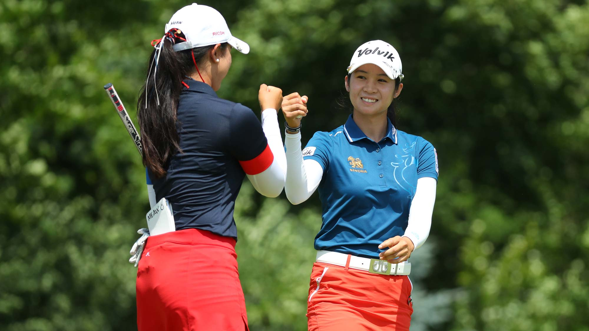 Teammates Pajaree Anannarukarn (L) and Pannarat Thanapolboonyaras of Thailand celebrate on the sixth green during round three of the Dow Great Lakes Bay Invitational