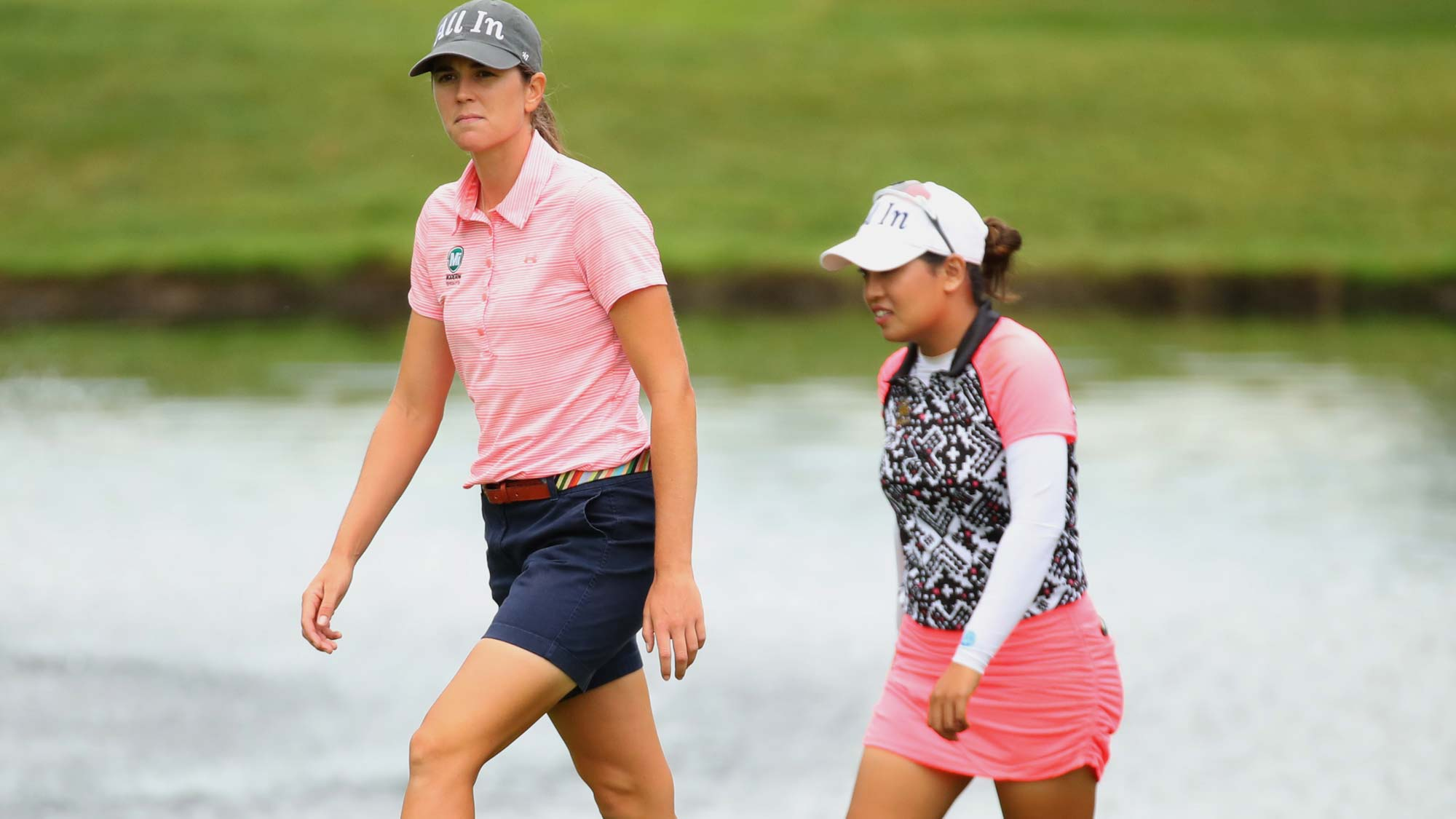 Teammates Cydney Clanton of the United States and Jasmine Suwannapura of Thailand walk to the fifth green during the final round of the Dow Great Lakes Bay Invitational