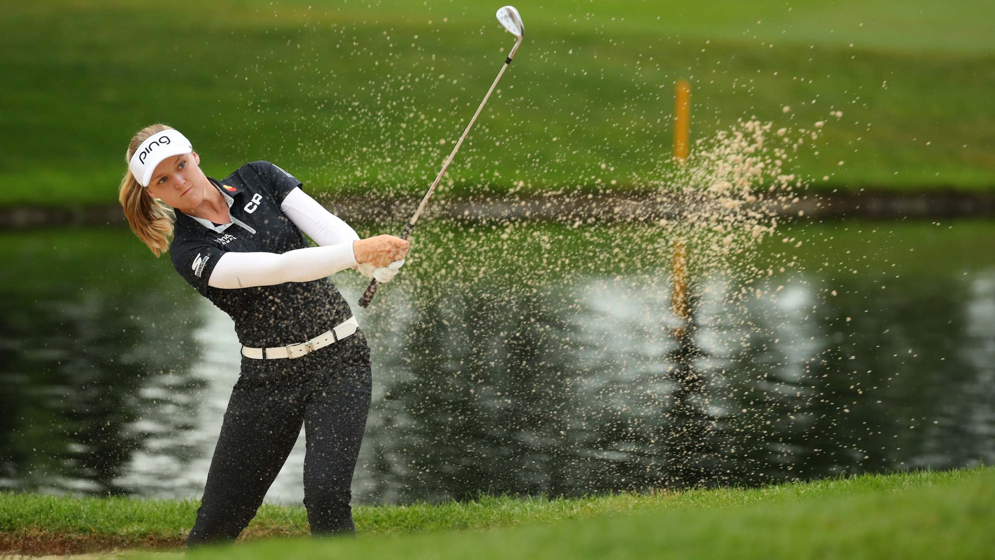 Brooke Henderson hits to the fifth green from a sand trap during the final round of the Dow Great Lakes Bay Invitational