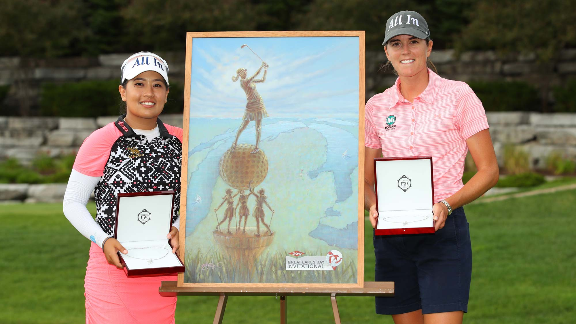 Teammates Cydney Clanton of the United States (R) and Jasmine Suwannapura of Thailand pose with the championship trophy and necklace after winning the Dow Great Lakes Bay Invitational