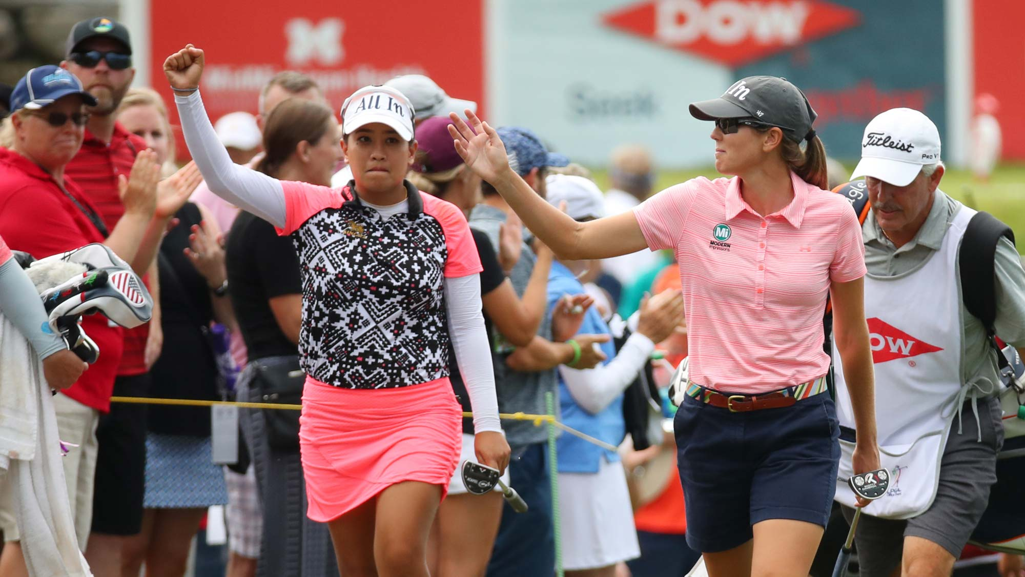 Teammates Cydney Clanton of the United States (R) and Jasmine Suwannapura of Thailand walk to the 18th green during the final round of the Dow Great Lakes Bay Invitational