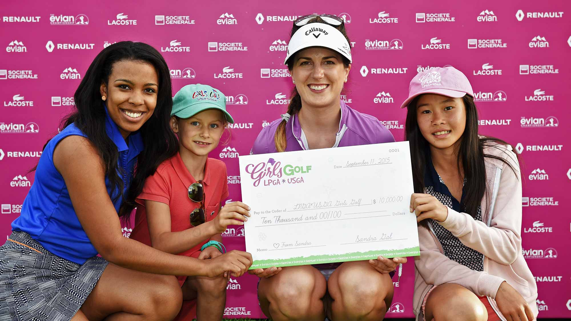 Sandra Gal presents a check for $10,000 to LPGA Girls Golf during the second round of the Evian Championship