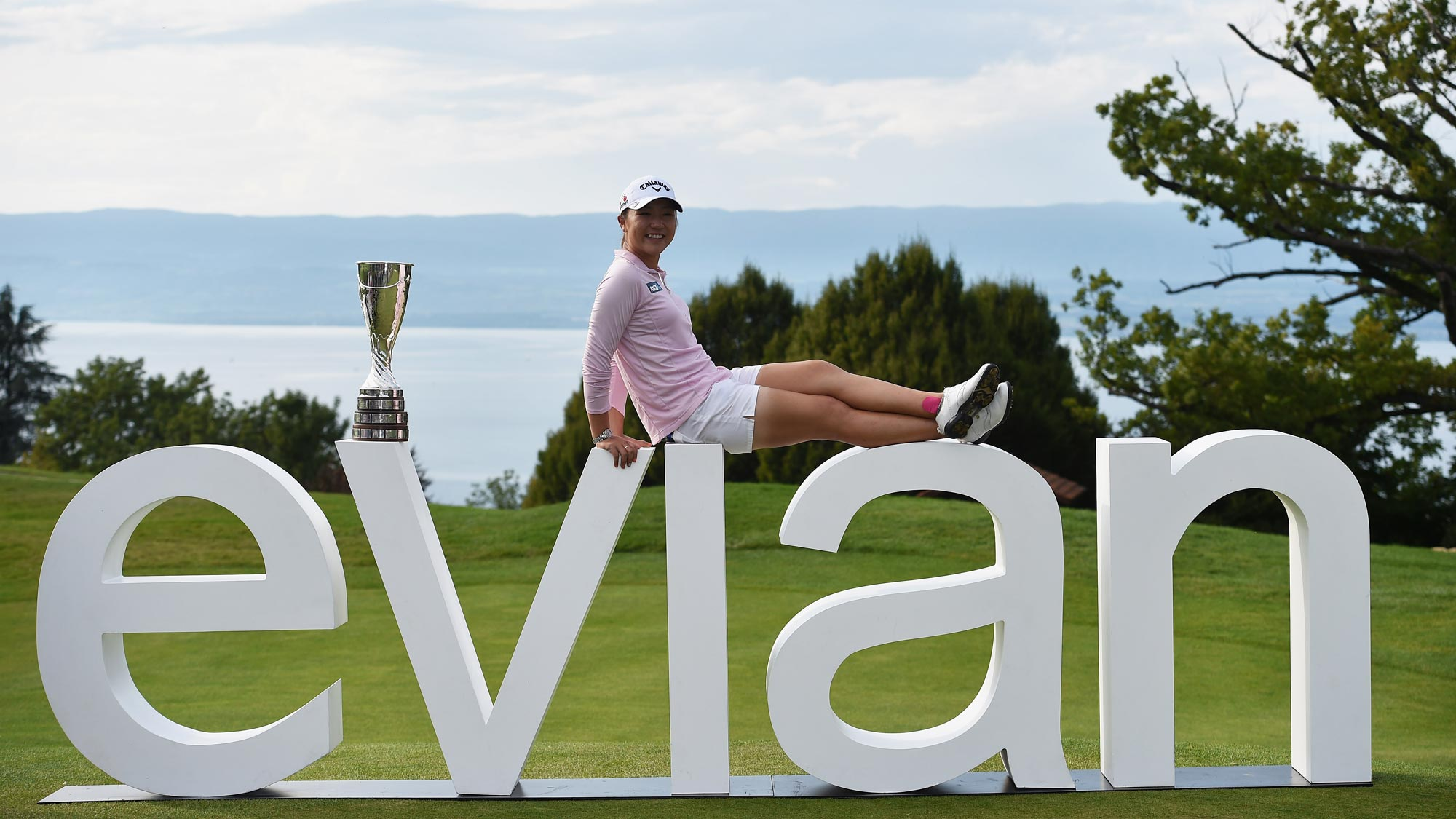 Lydia Ko poses with the giant Evian sign and her new Evian Championship Trophy after winning her first career major
