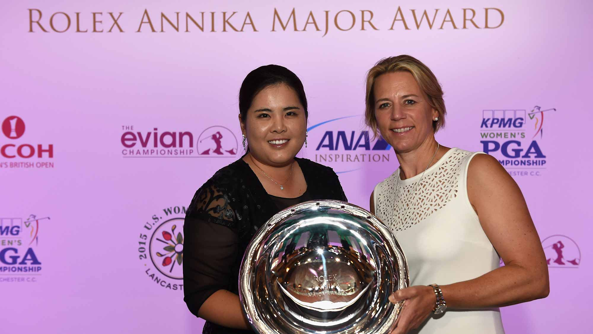Inbee Park presented with the Rolex Annika Major Award by Annika Sorestam at the Rolex Award ceremony after the third round of the Evian Championship