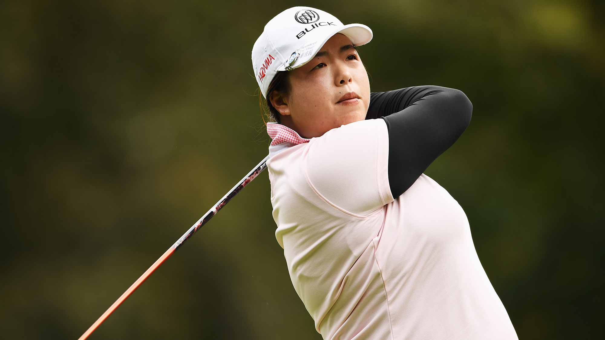 Shanshan Feng of China plays a shot during the third round of The Evian Championship
