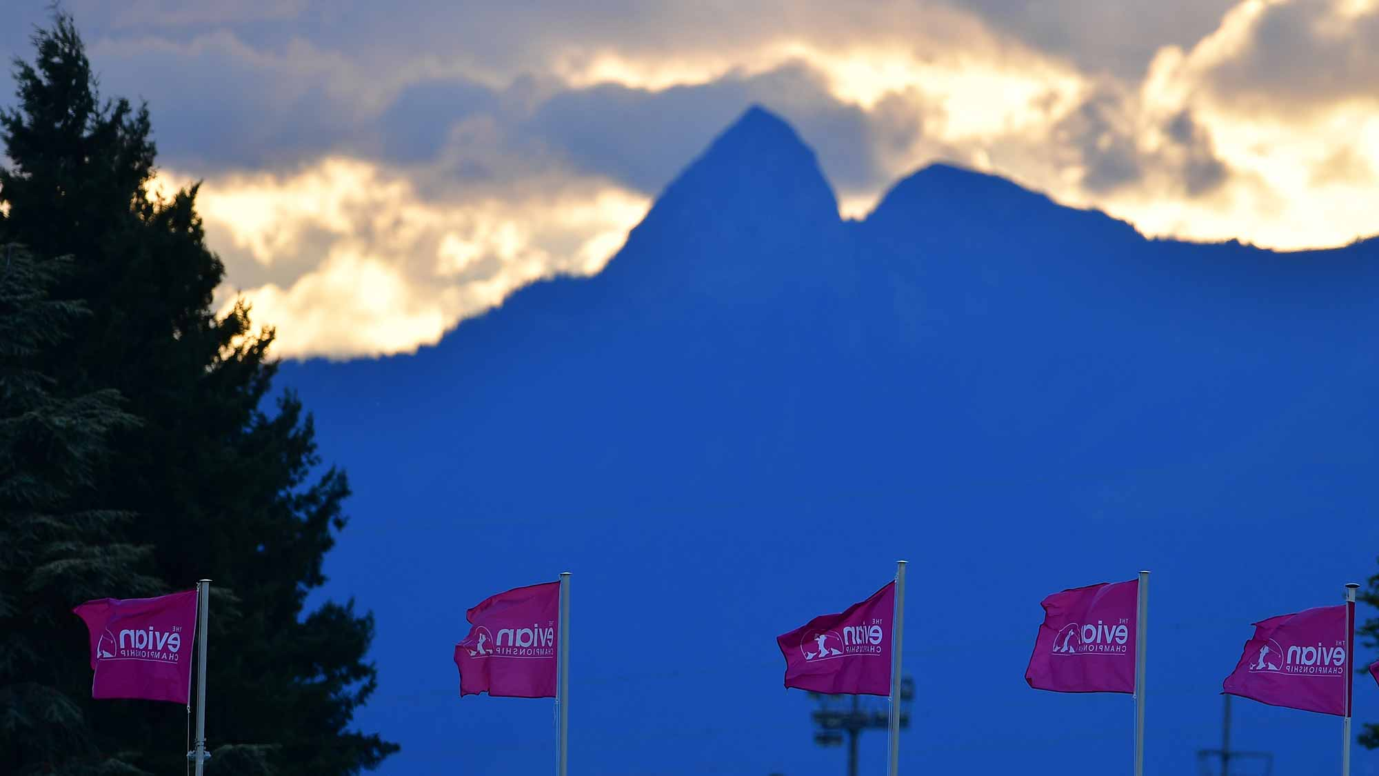 The sun rises above the Alps before the first round of the Evian Golf Club in Evian-les-Bains, France.