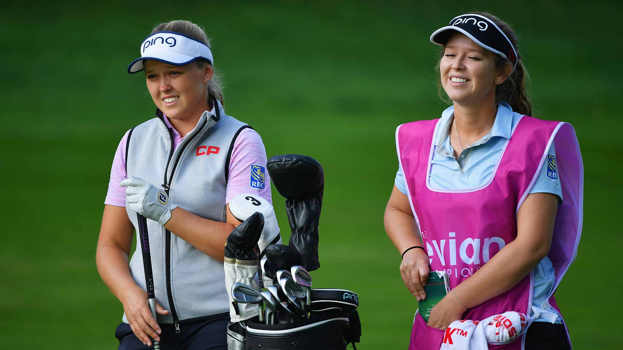 Brooke Henderson of Canada and caddie look on during day one of the Evian Championship at Evian Resort Golf Club on September 13, 2018 in Evian-les-Bains, France