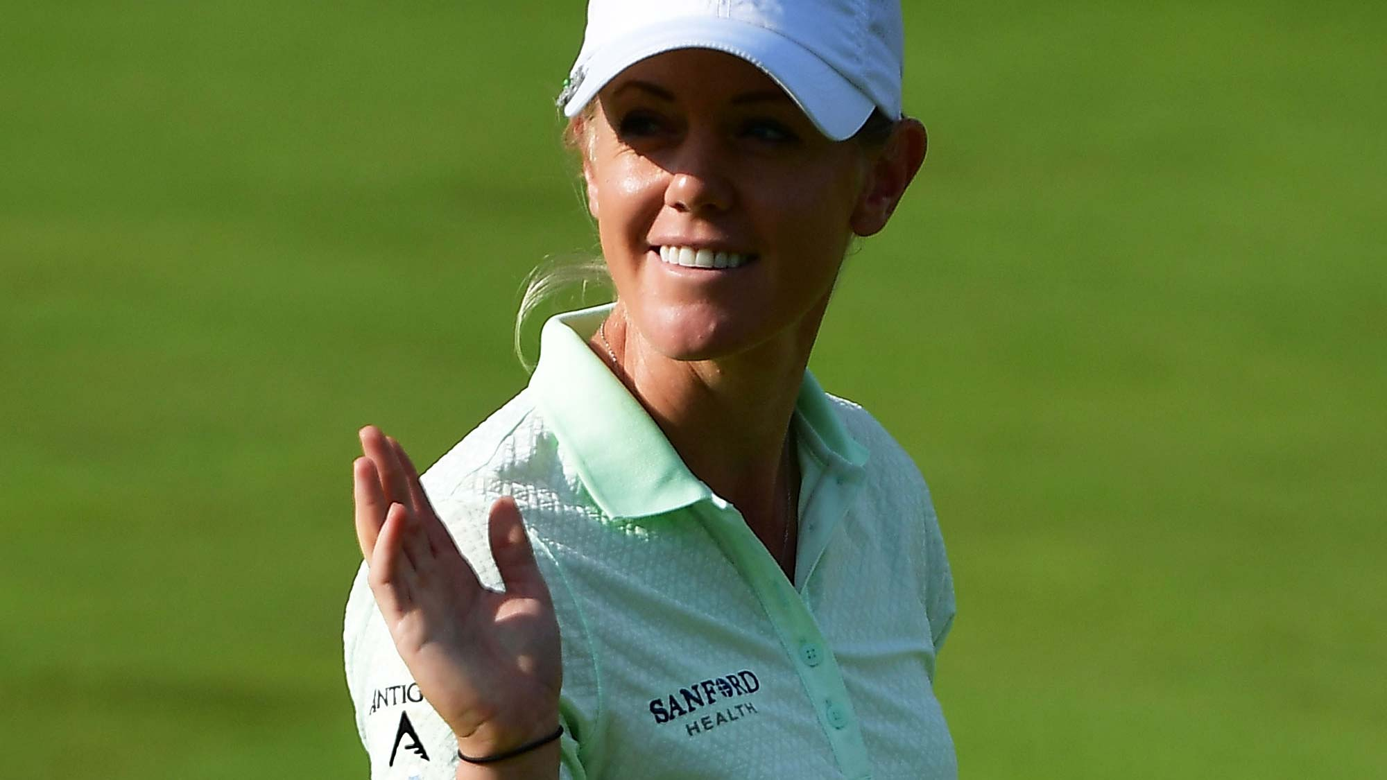 Amy Olson of The United States acknowledges the crowd during day two of the Evian Championship
