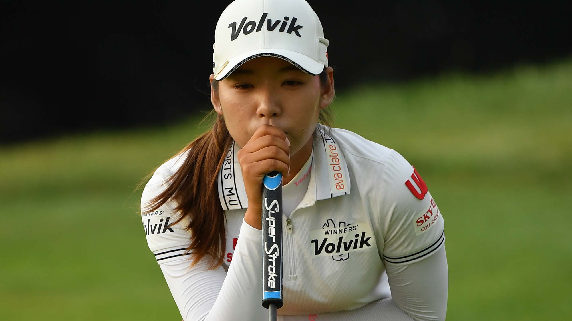 Mi Hyang Lee of Korean lines up a putt during day 1 of the Evian Championship