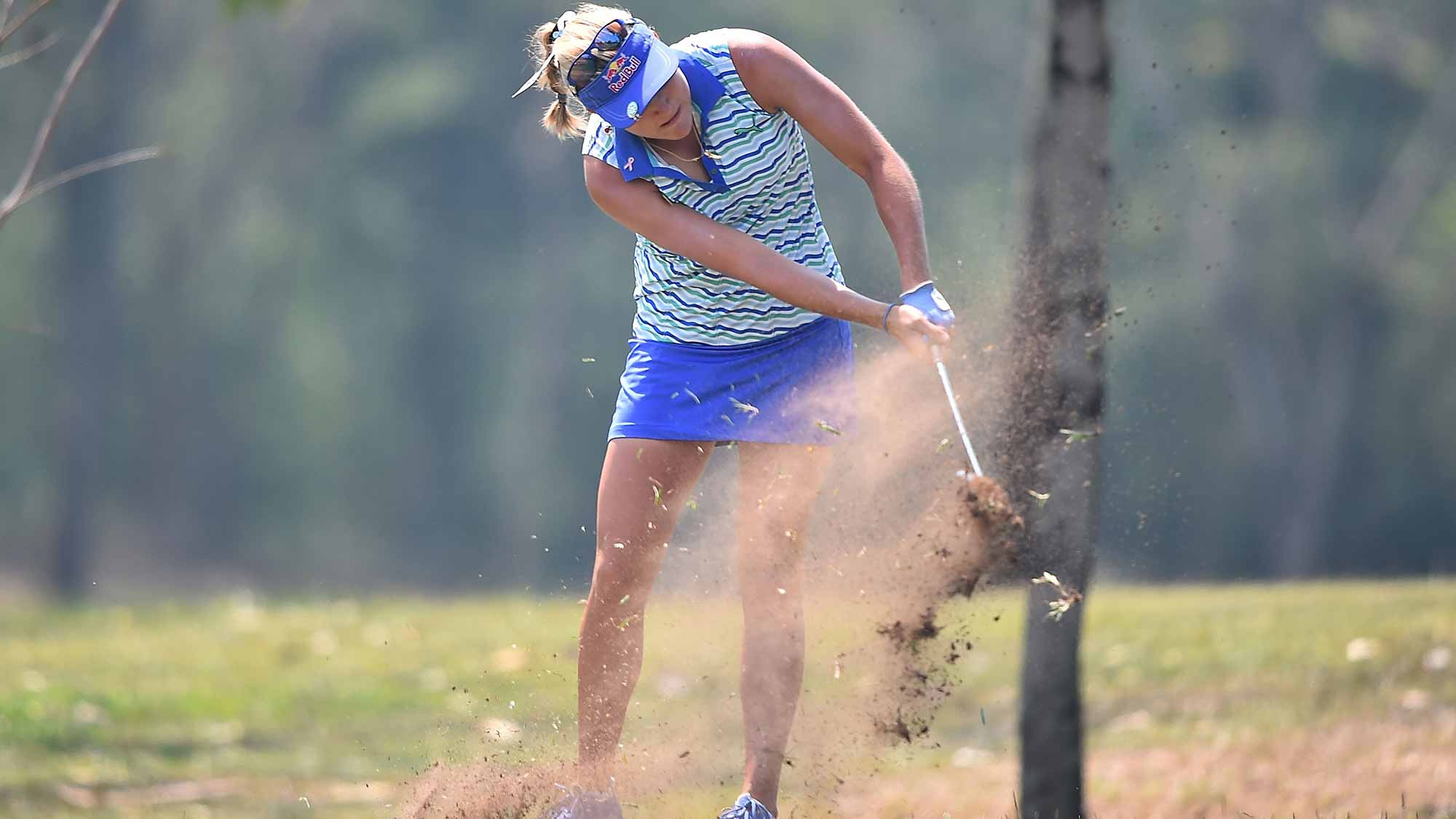 Lexi Thompson of the United States plays a shot during day four of the 2016 Honda LPGA Thailand at Siam Country Club