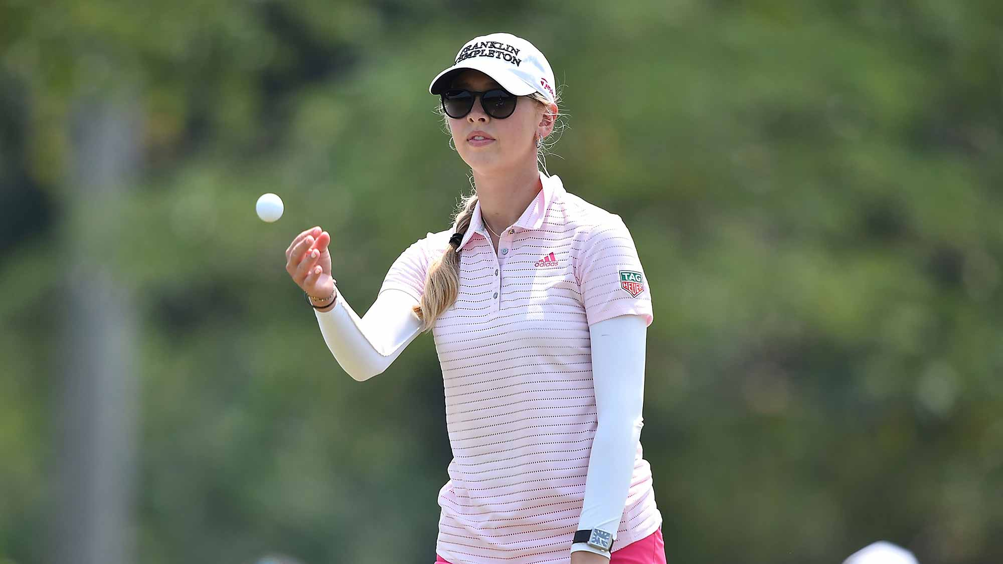Jessica Korda of the United States throws a golf ball during day three of the 2016 Honda LPGA Thailand at Siam Country Club