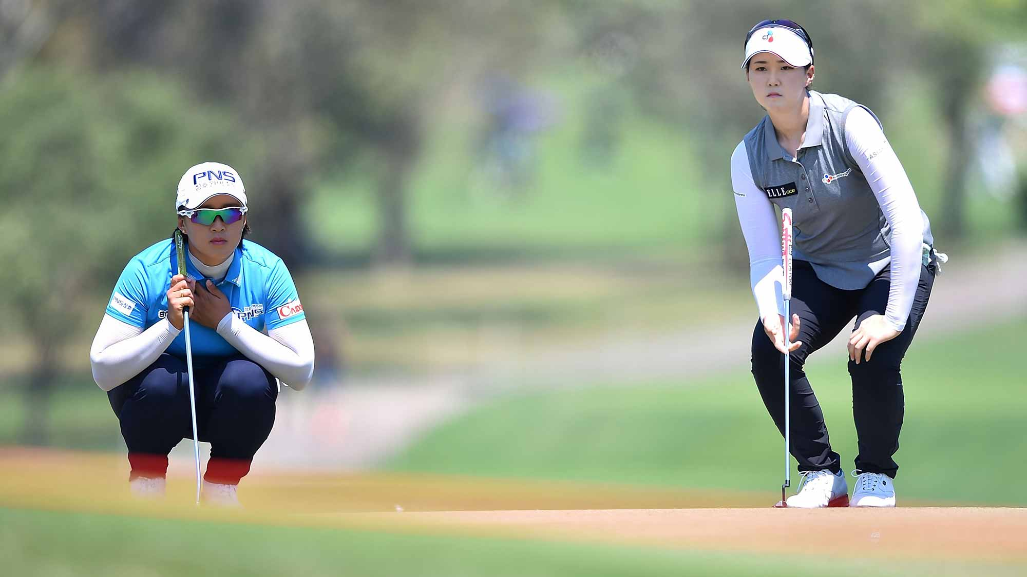 Amy Yang and Q Baek of South Korea looks on during day two of the 2016 Honda LPGA Thailand at Siam Country Club