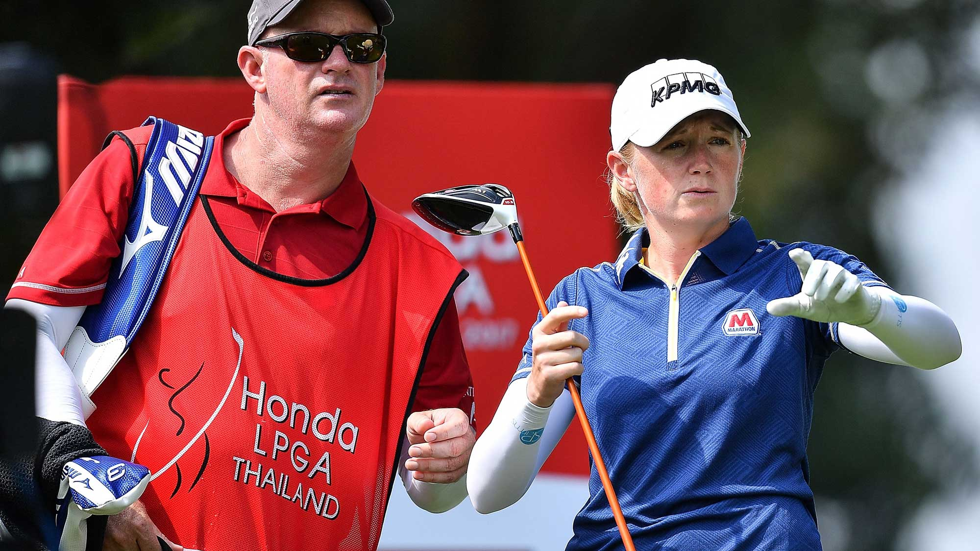 Stacy Lewis of United States talks with her caddy during the Honda LPGA Thailand