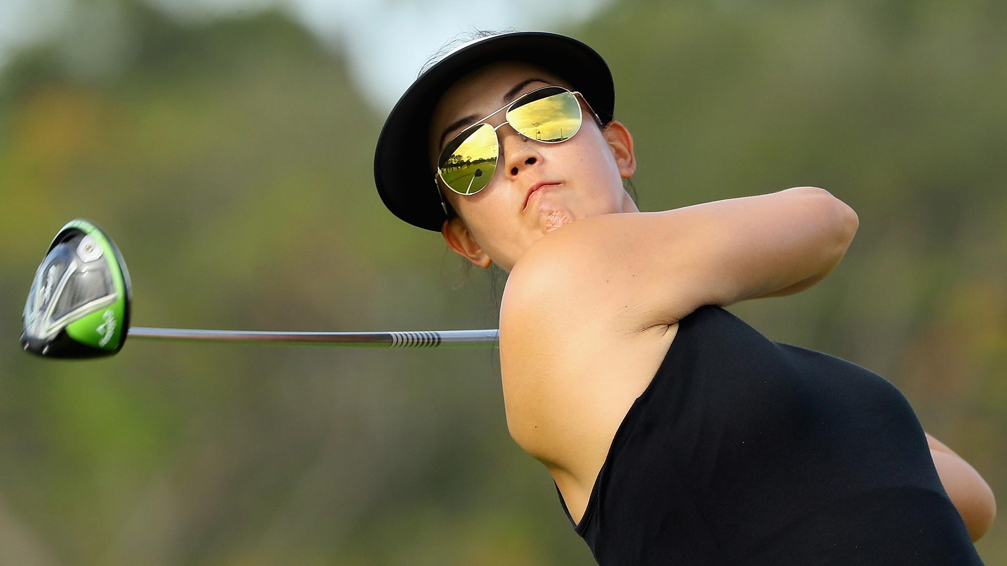 Wie opens with 66, takes 1-shot lead in Singapore