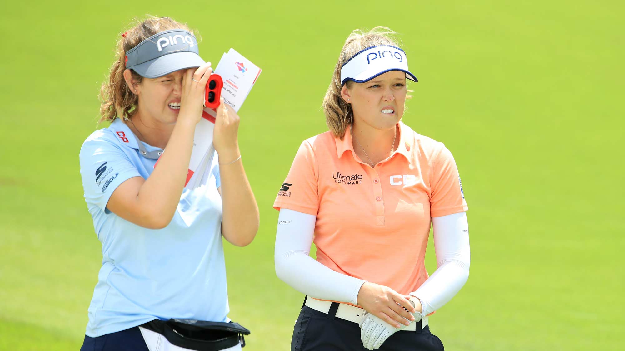 Brooke Henderson of Canada and her sister, caddie Brittany Henderson look on during a practice round prior to the HSBC Women's World Championship at Sentosa Golf Club on February 26, 2019 in Singapore.