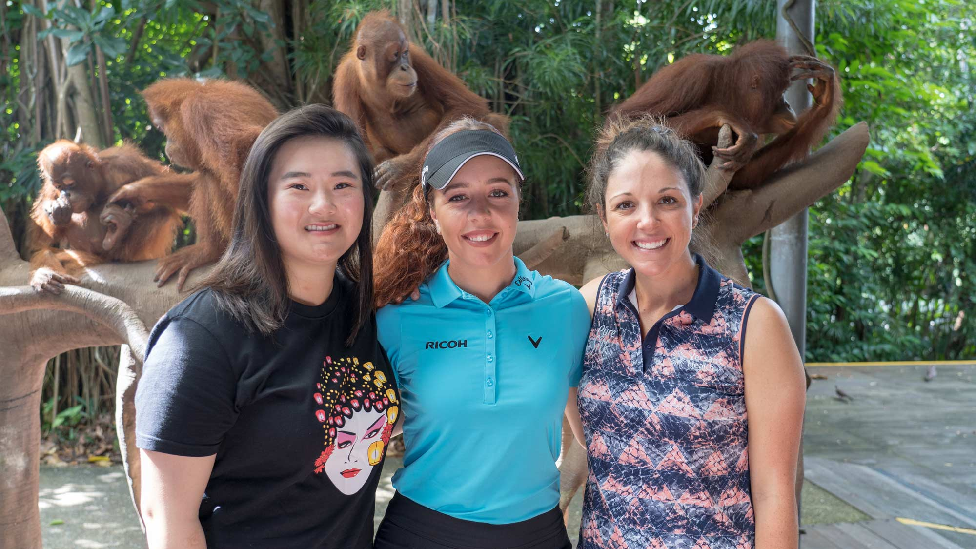 Angel Yin, Georgia Hall and Emma Talley visit with orangutans at the zoo after their opening practice round February 26th, 2019.