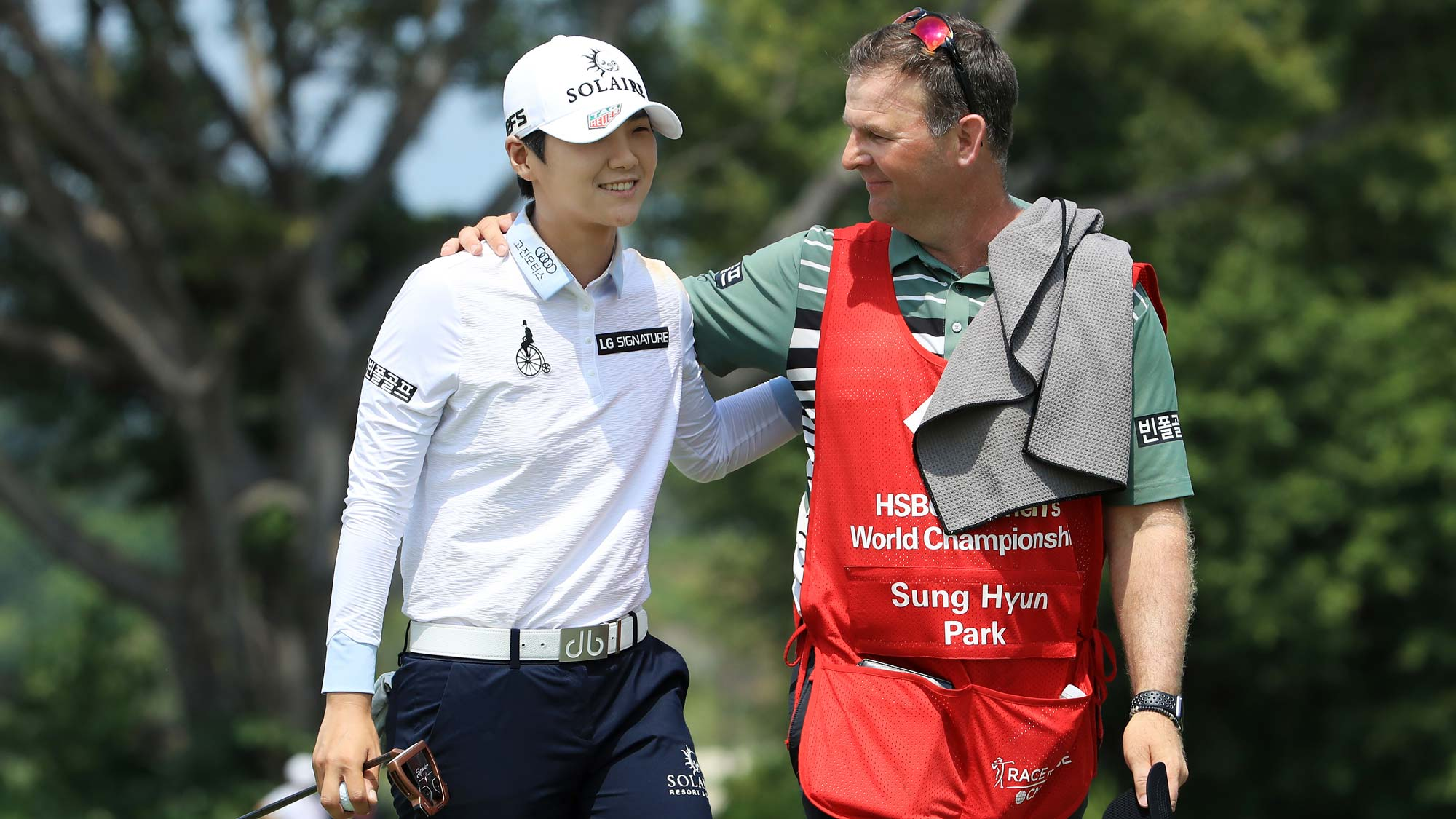 Sung Hyun Park of South Korea and her caddie, David Jones, celebrate after finishing on the 18th green during the final round of the HSBC Women's World Championship