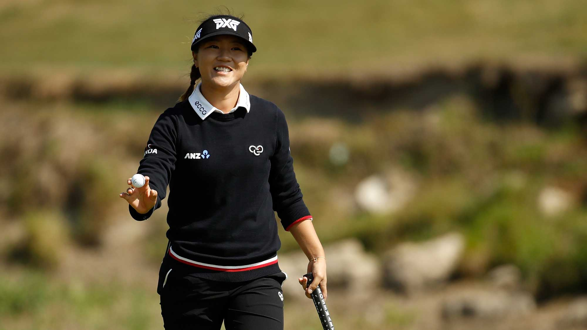 Lydia Ko of New Zealand waves to the crowd after making birdie on the 5th hole during the final round of the Indy Women In Tech Championship-Presented By Guggenheim