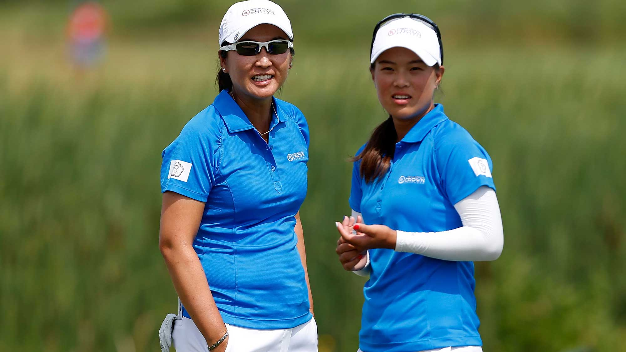 Candie Kung (L) and Ssu-Chia Cheng of Chinese Taipei stand on the fourth green during the four-ball session of the 2016 UL International Crown