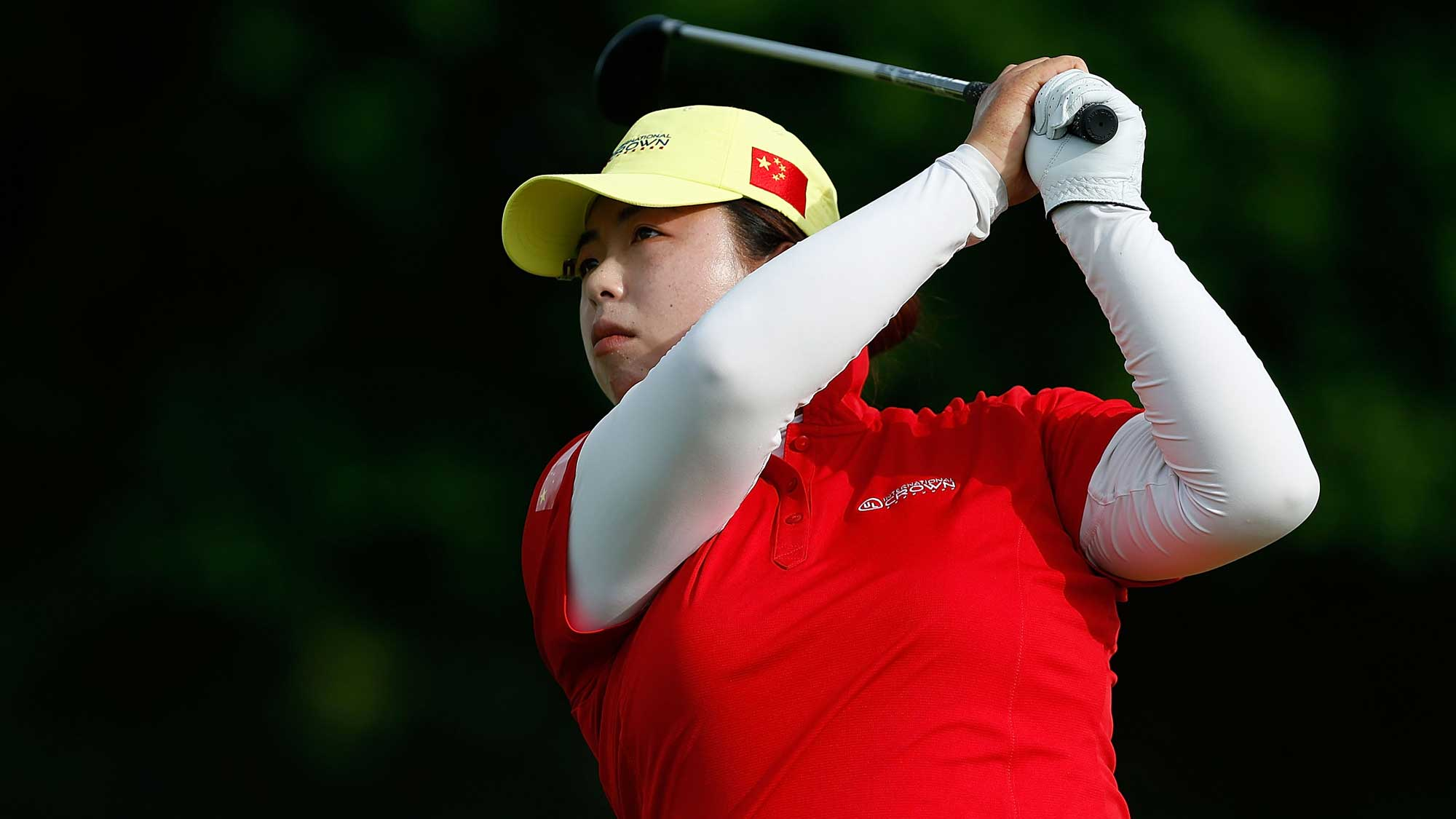 Shanshan Feng of China hits her tee shot on the second hole during the four-ball session of the 2016 UL International Crown