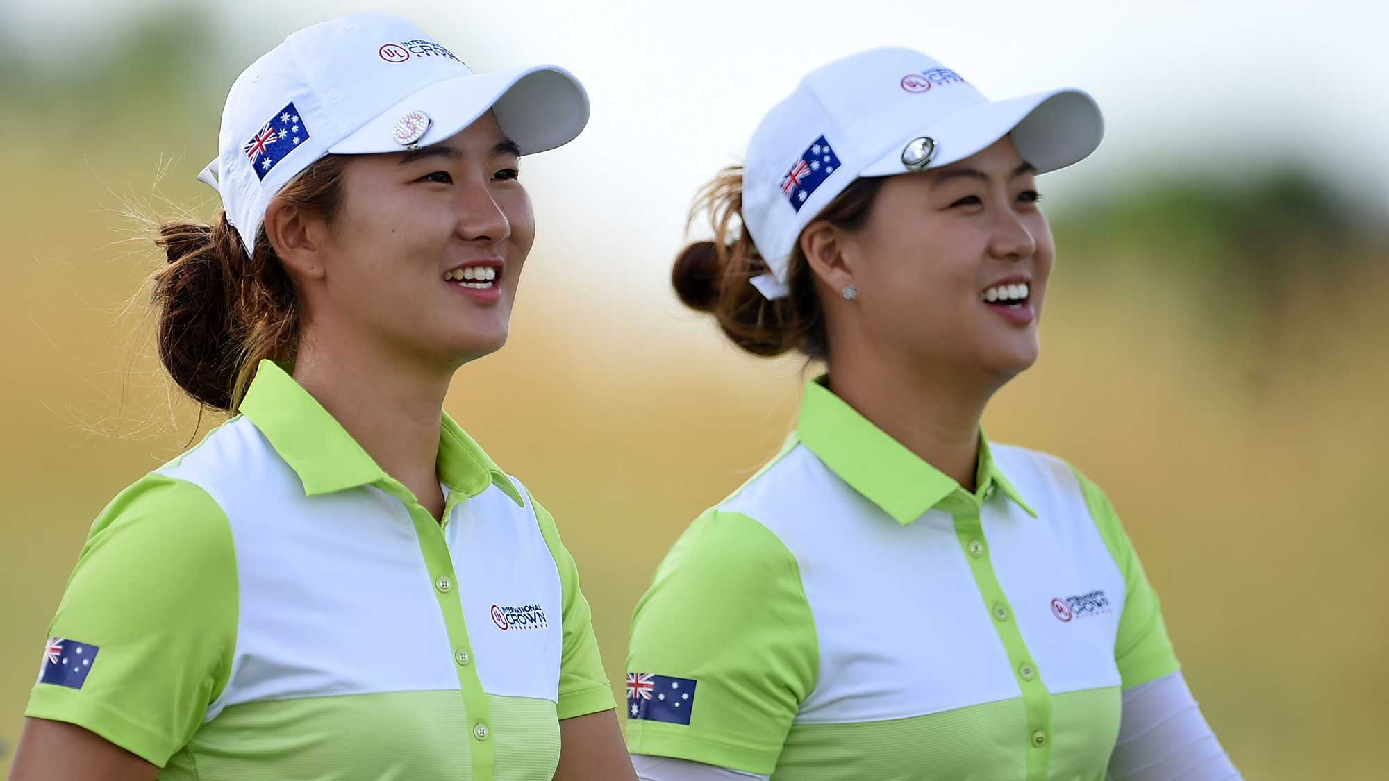(L) Su Oh and (R) Minjee Lee of Australia walk off the 4th tee during the four-ball session of the 2016 UL International Crown