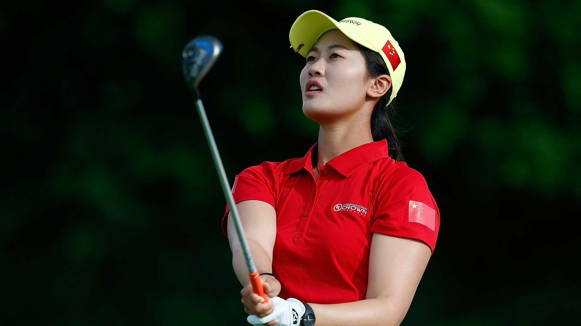 Xi Yu Lin of China hits her tee shot on the second hole during the four-ball session of the 2016 UL International Crown