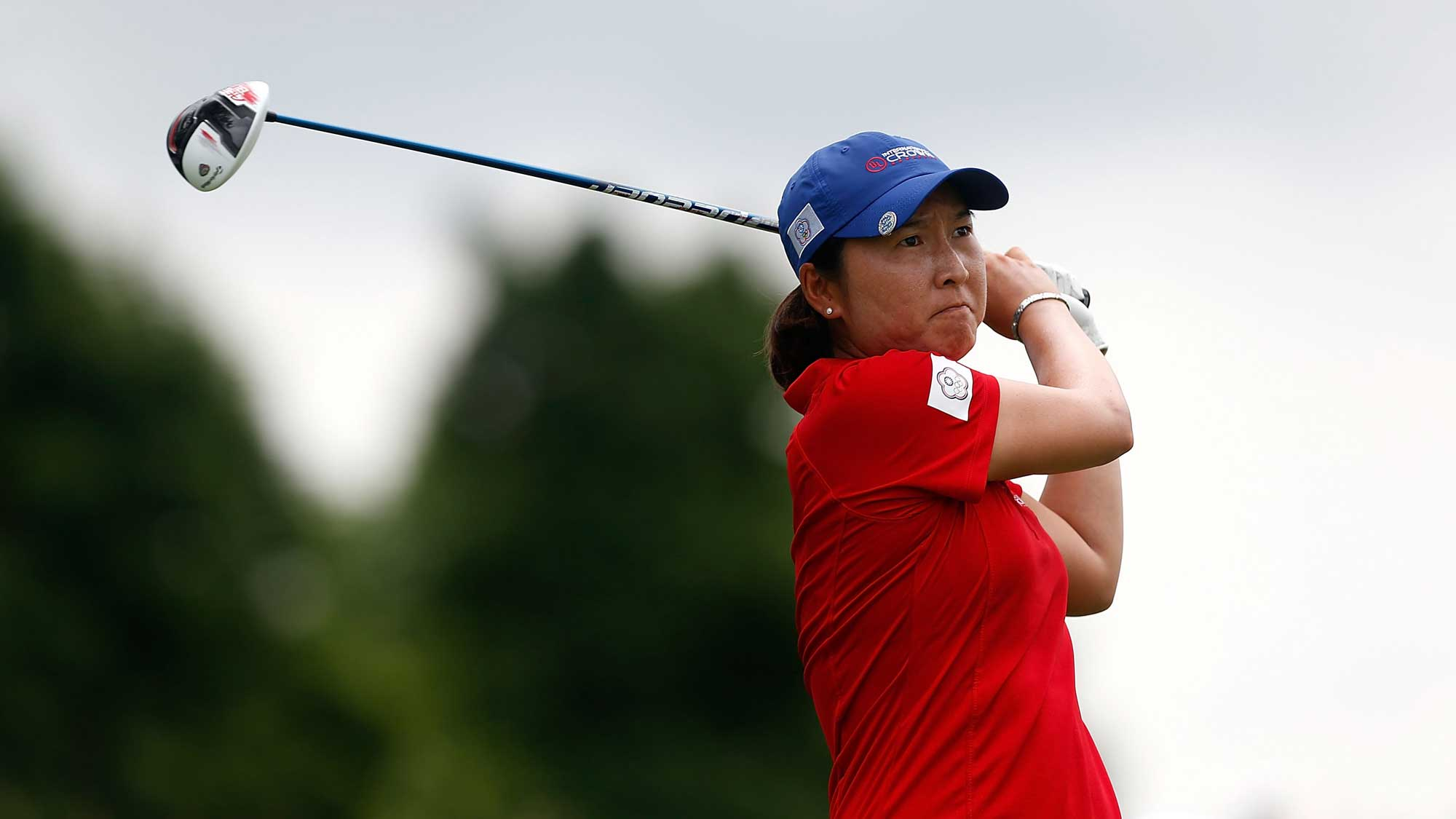 Candie Kung of Chinese Taipei hits her tee shot on the fourth hole during the four-ball session of the 2016 UL International Crown